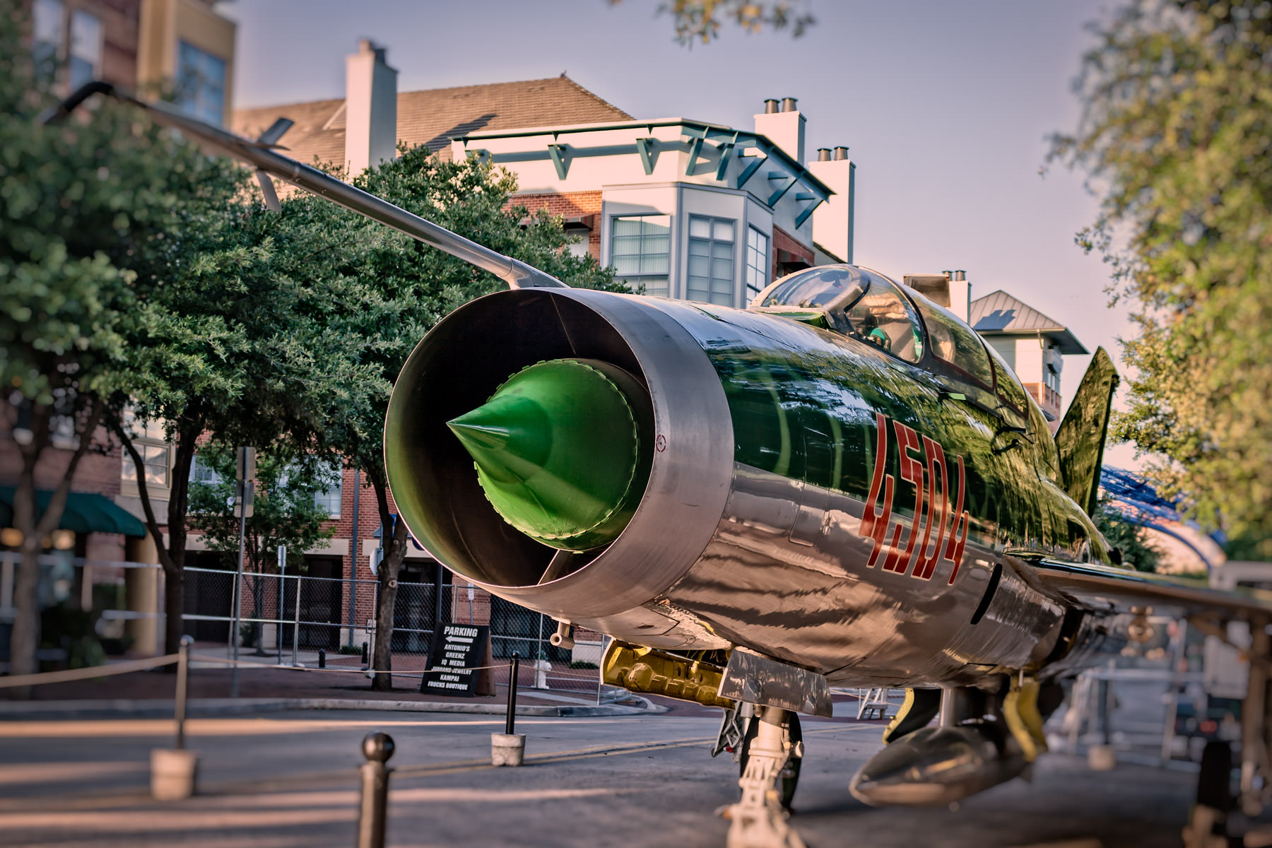"A Yugoslav variant of the MiG-21 ""Fishbed""—the MiG-21U-400 ""Mongol""—belonging to Addison, Texas' Cavanaugh Flight Museum sits in the street for Taste Addison."