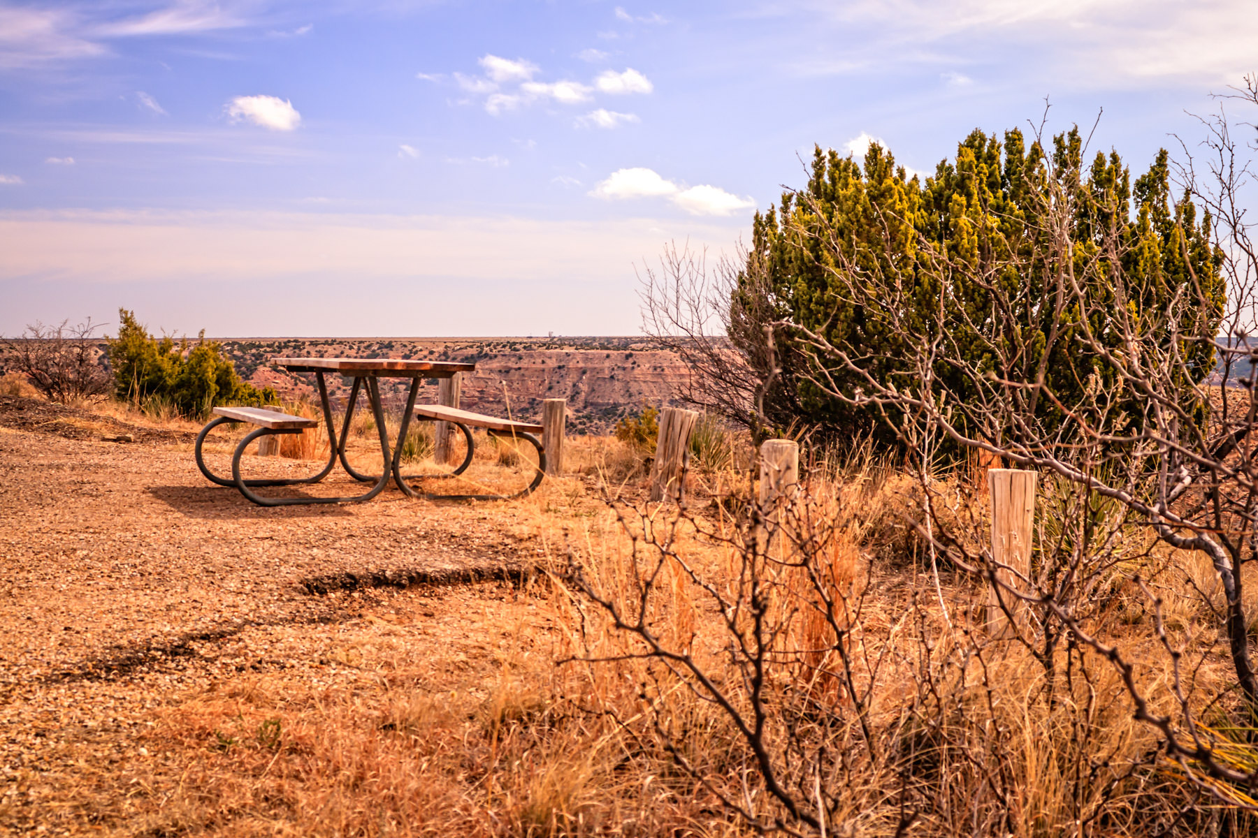 A lonesome picnic table overlooks Palo Duro Canyon, Texas.