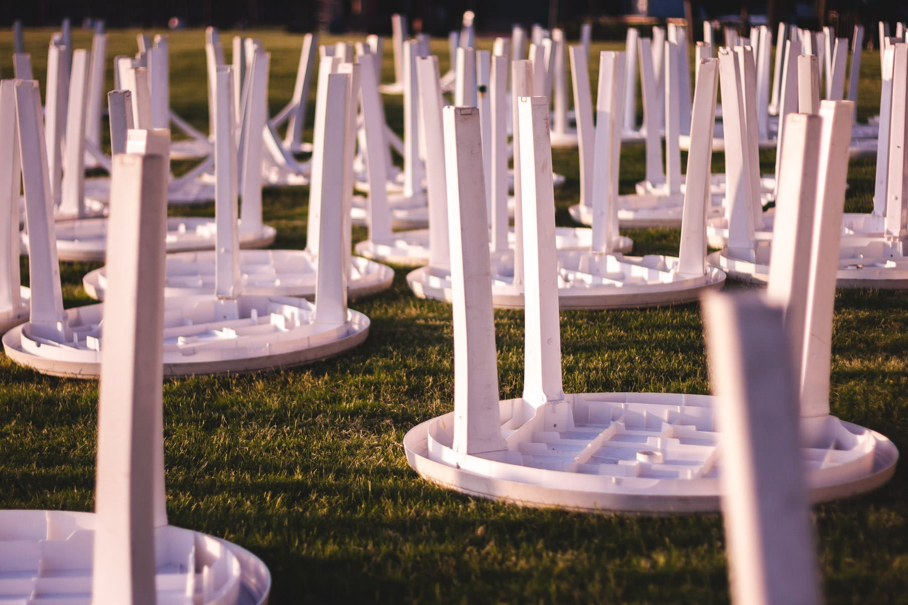 Tables laid out on the lawn at Addison Circle Park in preparation of Taste Addison.
