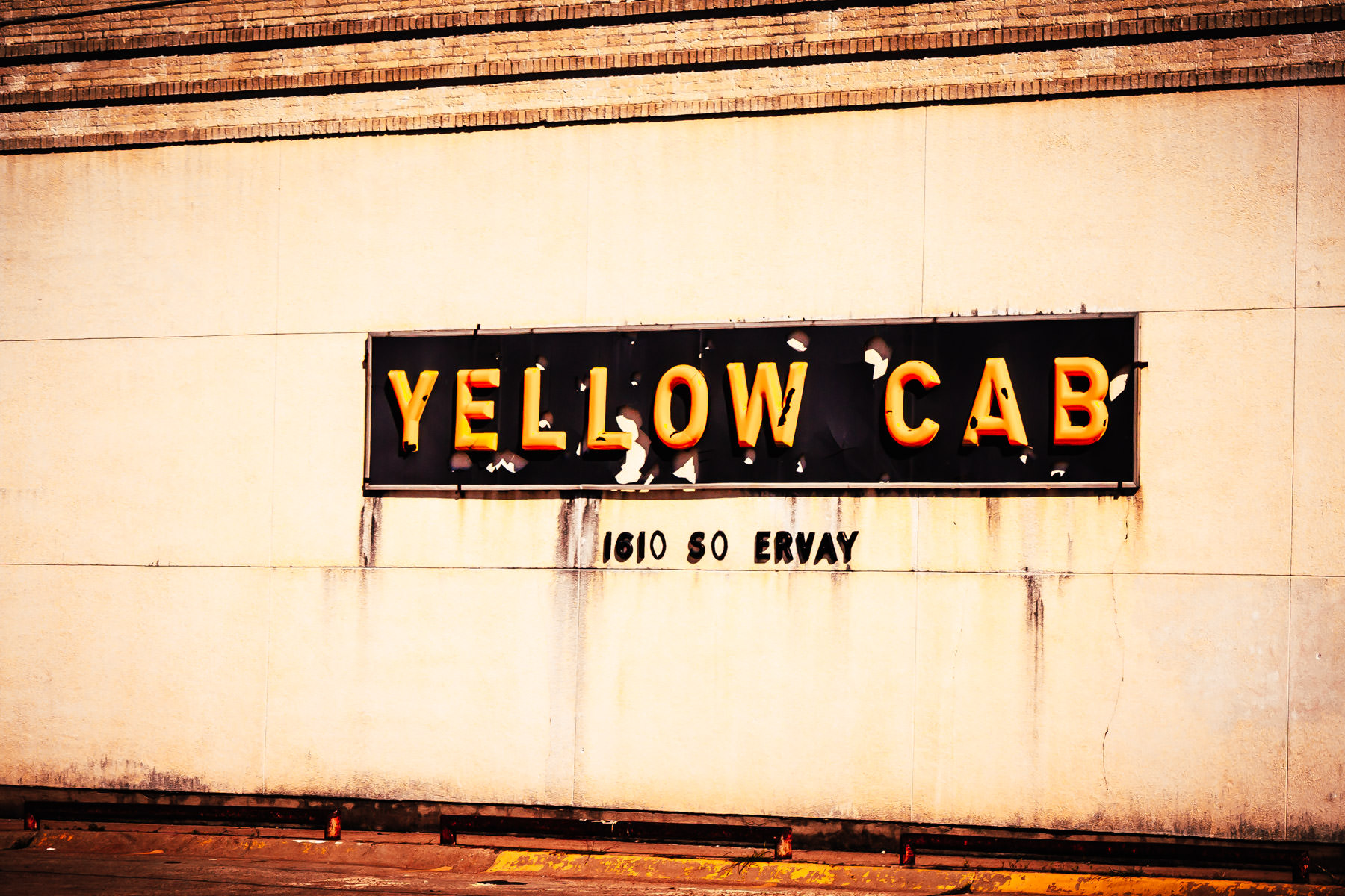 A decaying sign for the Yellow Cab company south of Downtown Dallas.