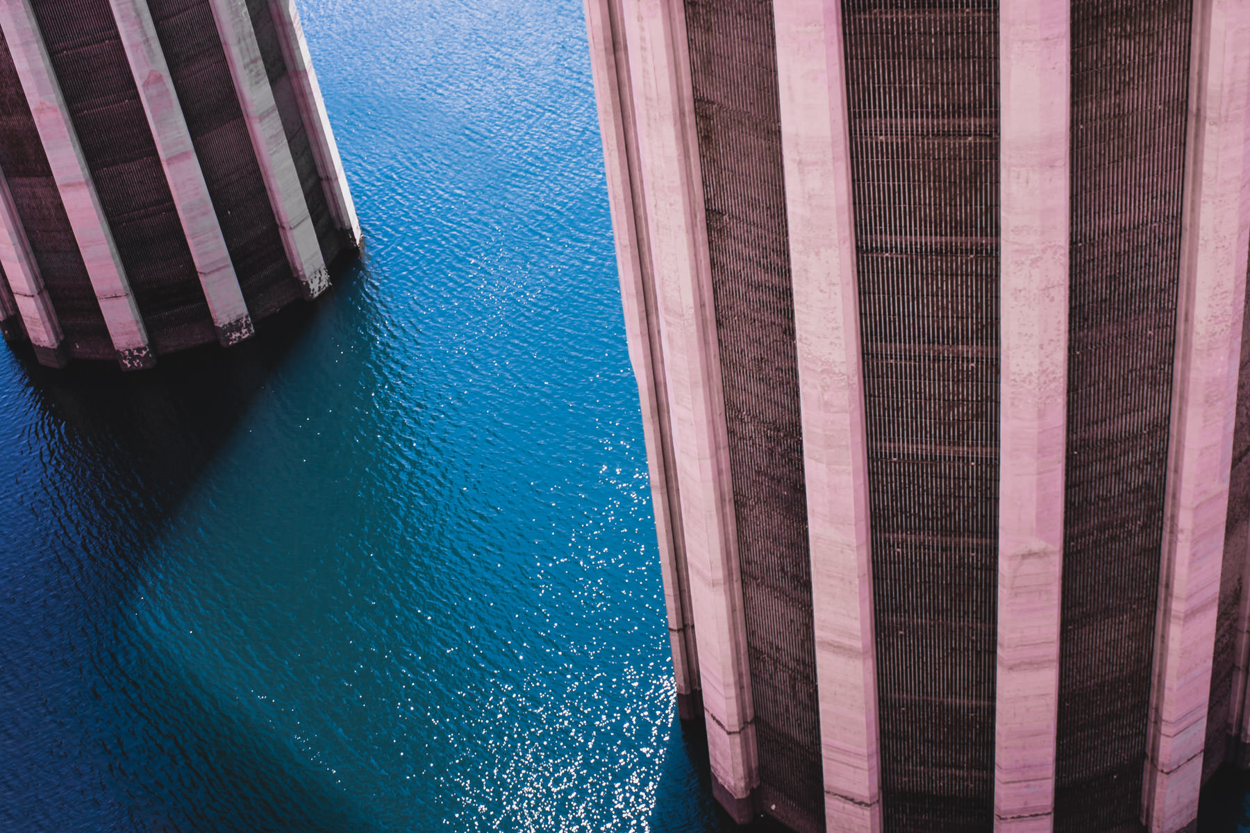 The two 395-feet-tall water intake towers rise out of the water on the Nevada side of Hoover Dam. Two nearly-identical towers are also on the Arizona side.