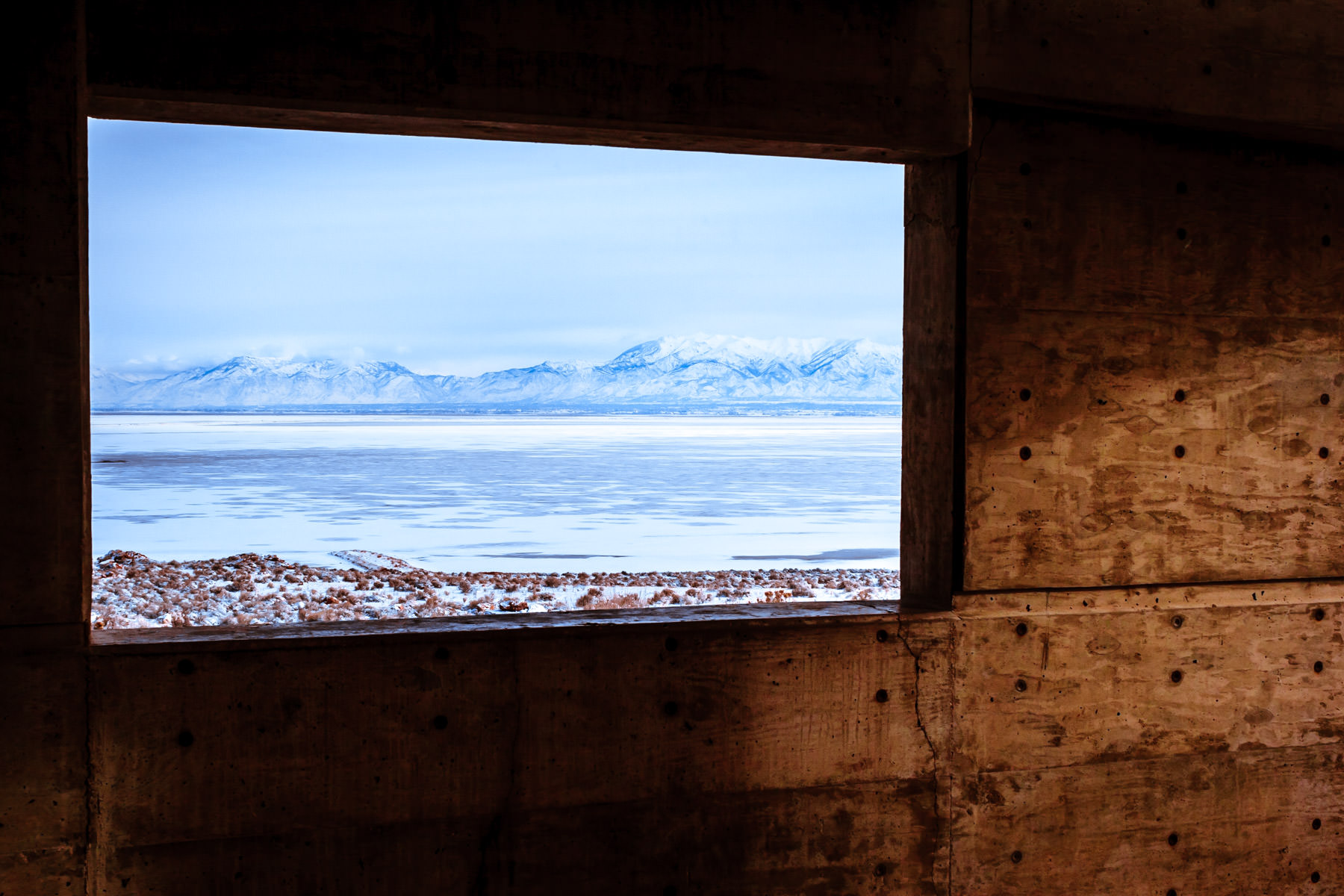 The Wasatch Front as seen through a window at the Antelope Island State Park Visitors Center, Utah.