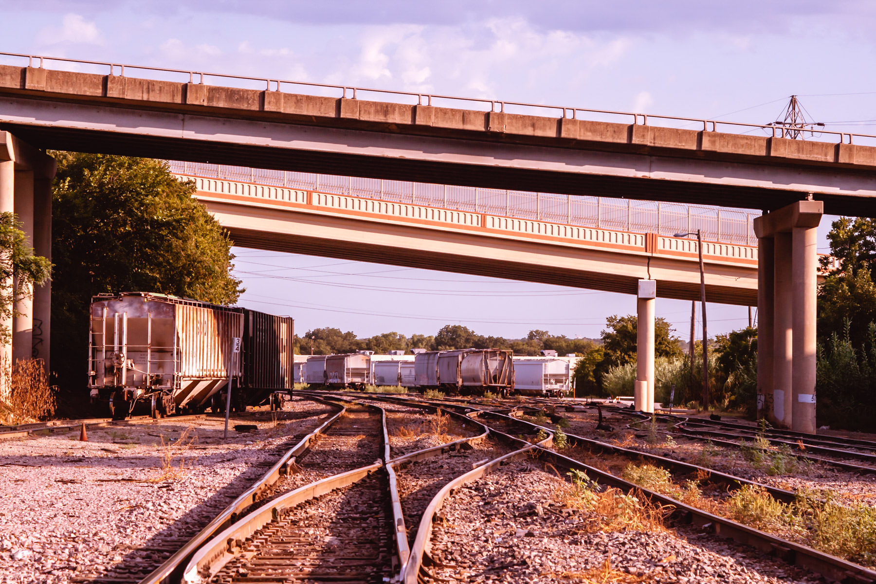 Rail cars sit idle underneath the Weatherford Street and Belknap Street bridges in Fort Worth, Texas.