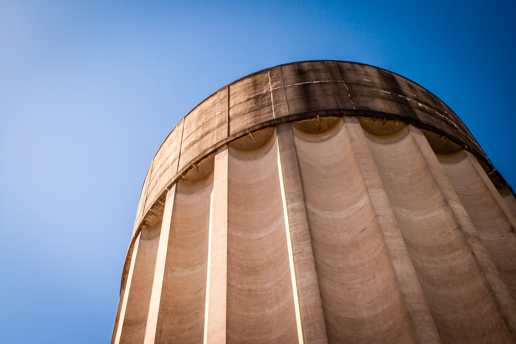 Detail of the top of a large concrete water tower in Tyler, Texas. Purportedly, it is one of the tallest concrete water towers in the world, but very little corroborating information about it can be found on the web.