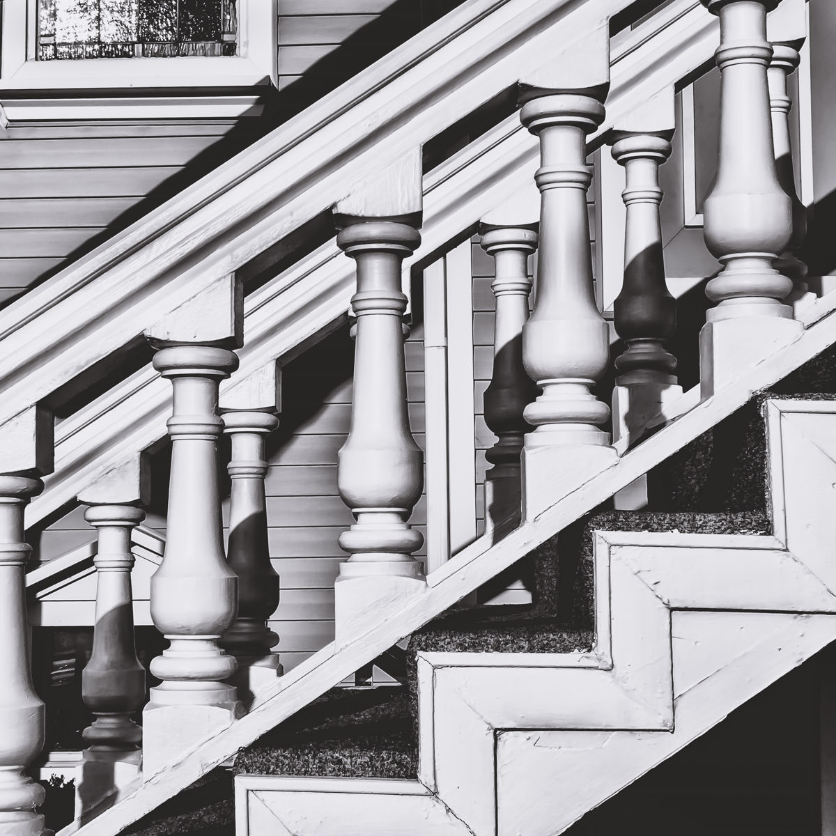 A stairway's ornate banister in Old Downtown Addison, Texas.