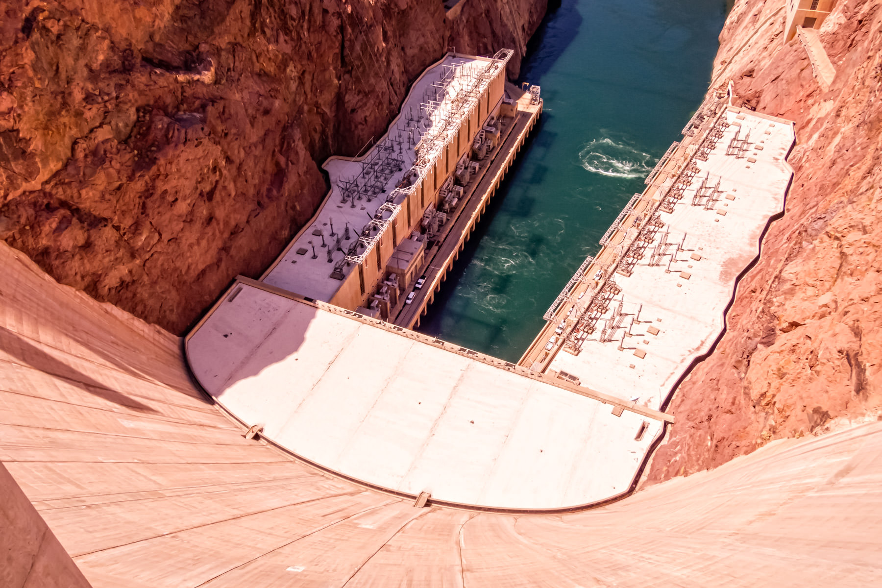 Looking down the 221 meter (726 ft.) tall Hoover Dam on the Colorado River at the border of Nevada and Arizona.