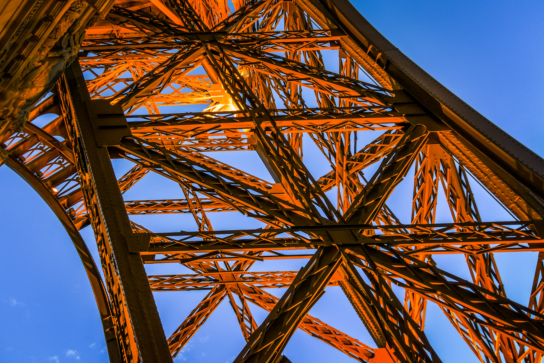 The iron stucture of one of the legs of the Paris Casino Hotel's reproduction of the Eiffel Tower catches the light of the late evening Las Vegas sun.