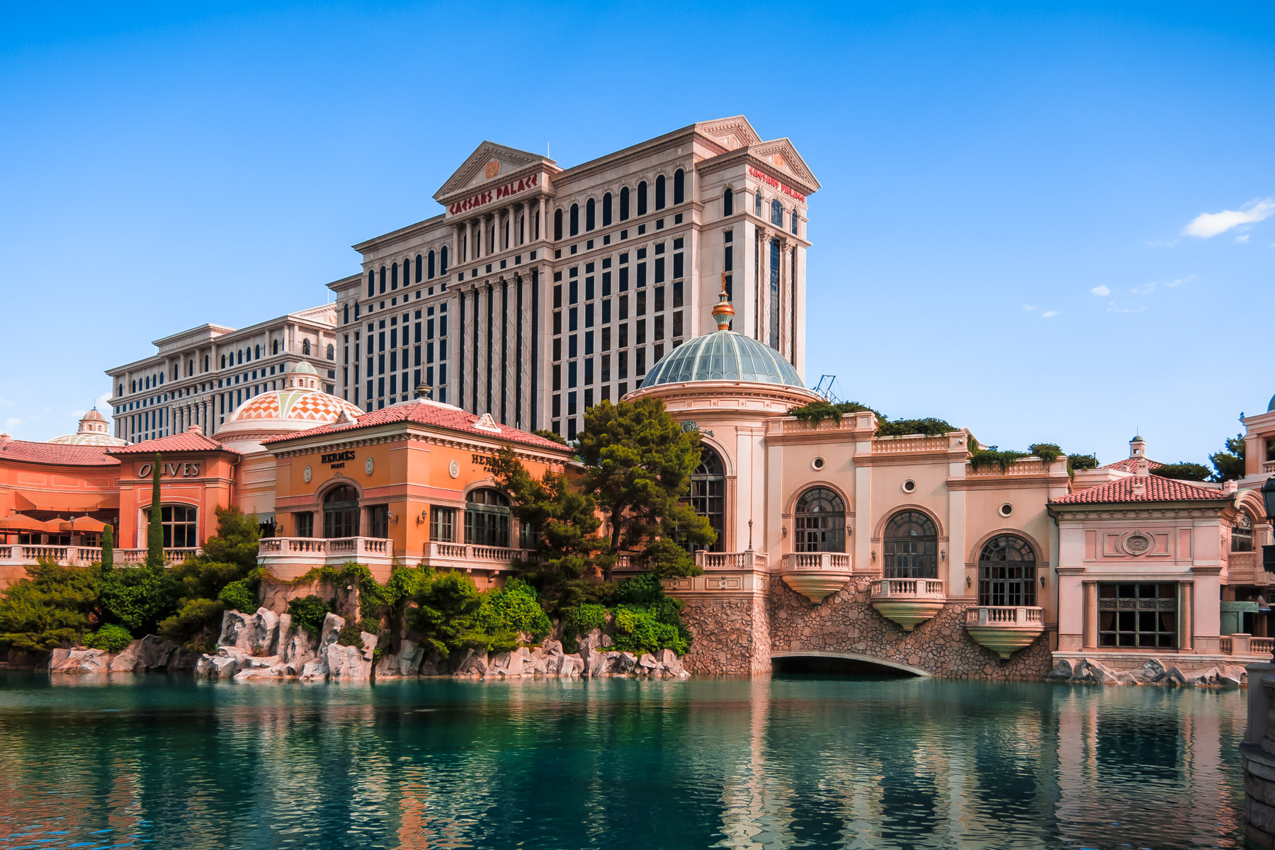 Two of Las Vegas' Caesars Palace's six towers—along with a portion of the Bellagio—are reflected in the 8-acre artificial lake in front of the latter hotel.