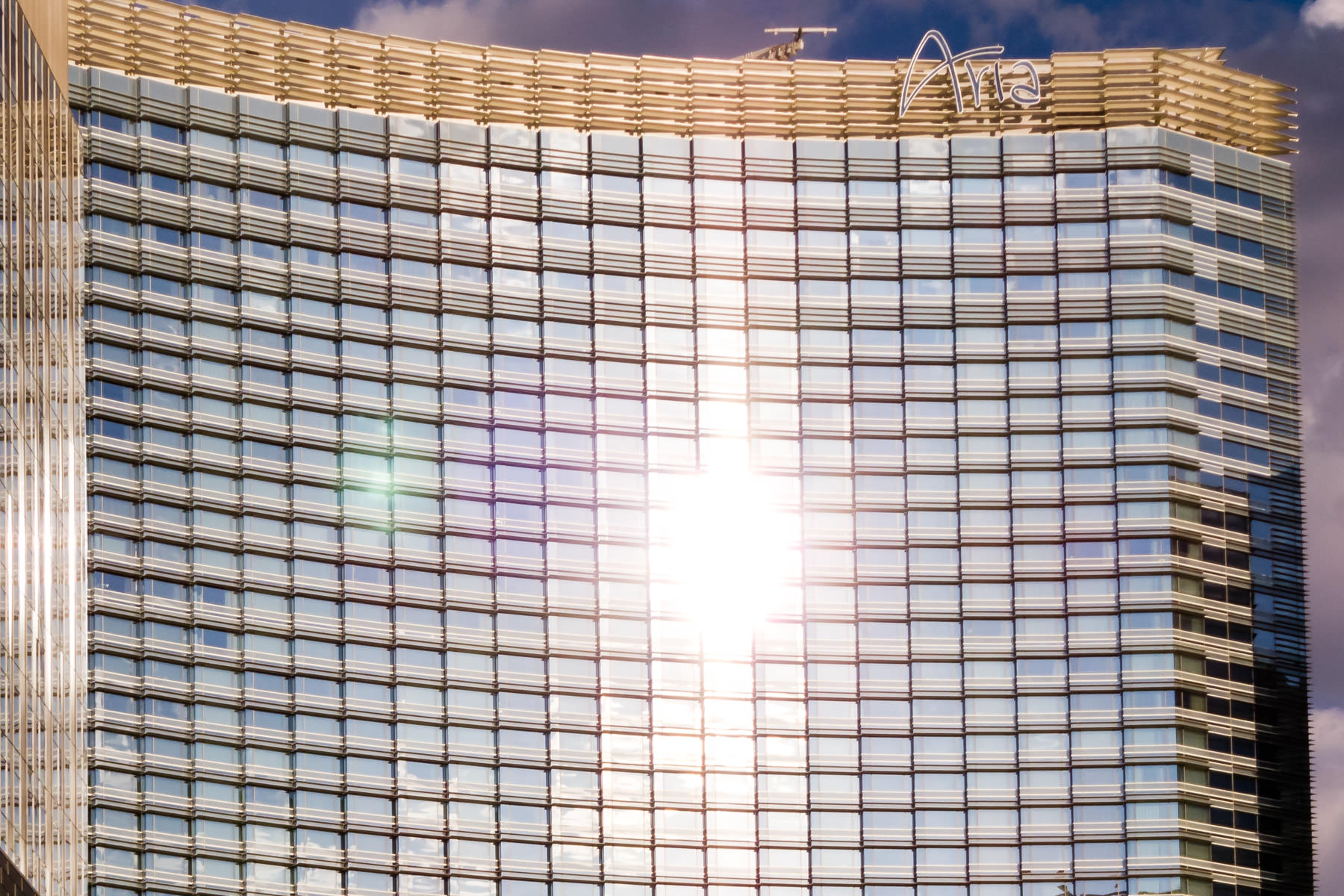 The sun glints off the windowed facade of the Aria, CityCenter, Las Vegas.