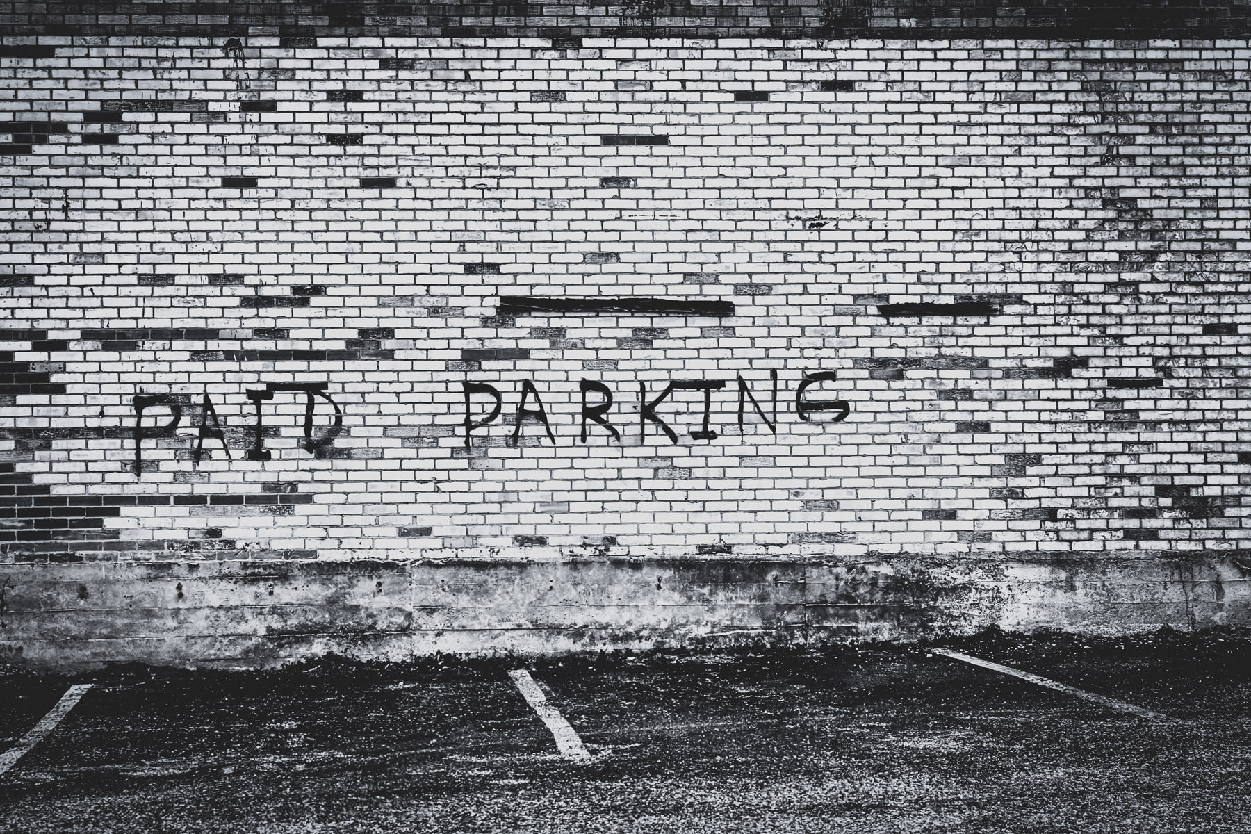 An admonishment in Downtown Tyler, Texas, blurs the line between sign and graffiti.