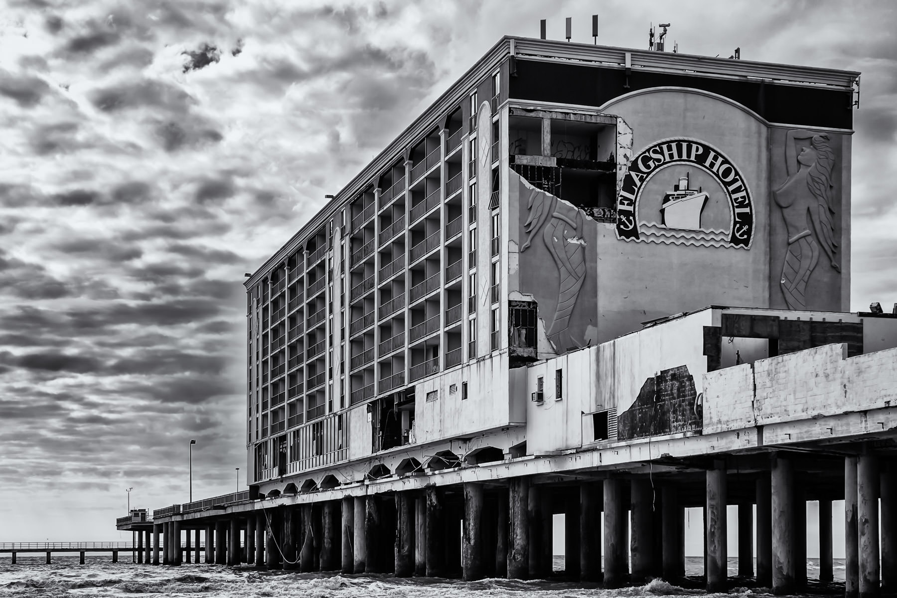 The Flagship Hotel, built on a pier extending from Galveston's Seawall Boulevard out into the Gulf of Mexico, sits damaged and abandoned in the aftermath of Hurricane Ike.
