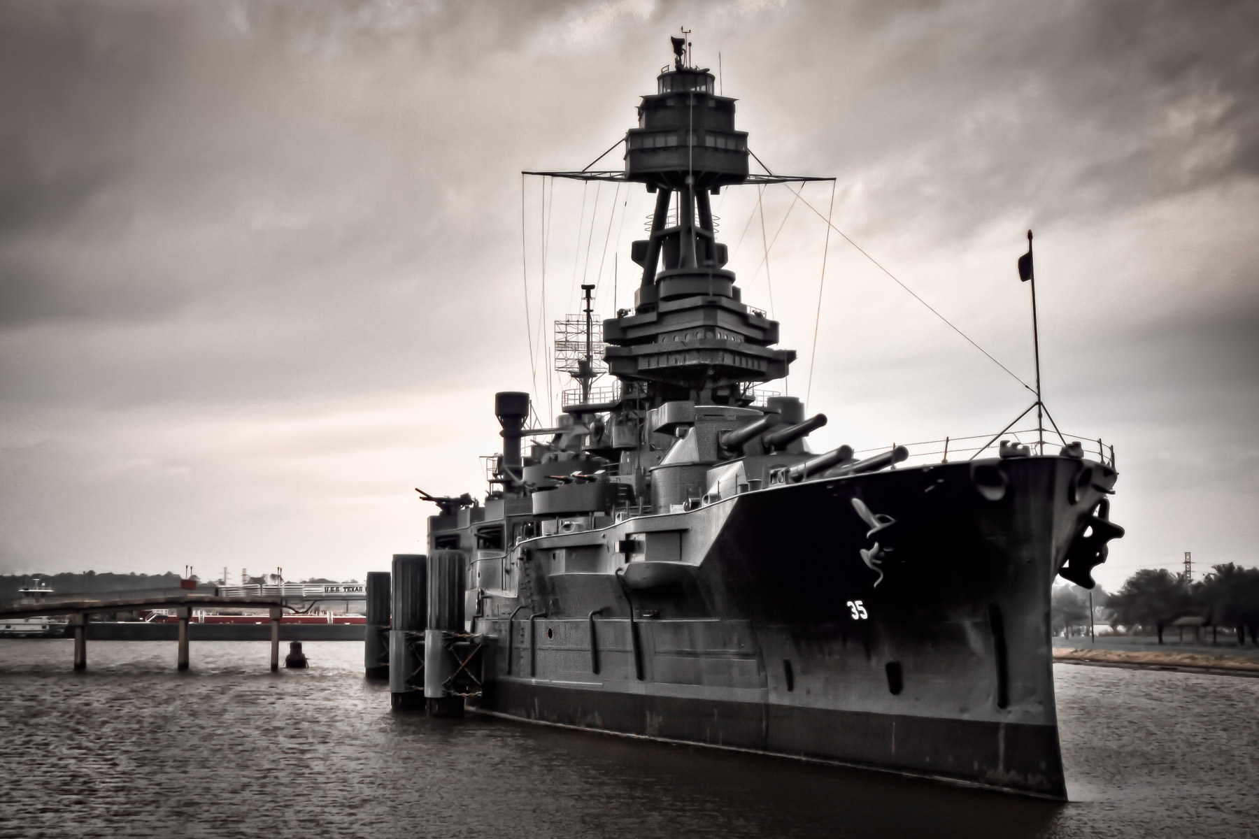 The USS Texas, commissioned in 1914, saw action in both World Wars, including D-Day and at Iwo Jima. After being decommissioned in 1947, she was permanently moored adjacent to the Houston Ship Channel near the San Jacinto Monument to act as a museum ship.