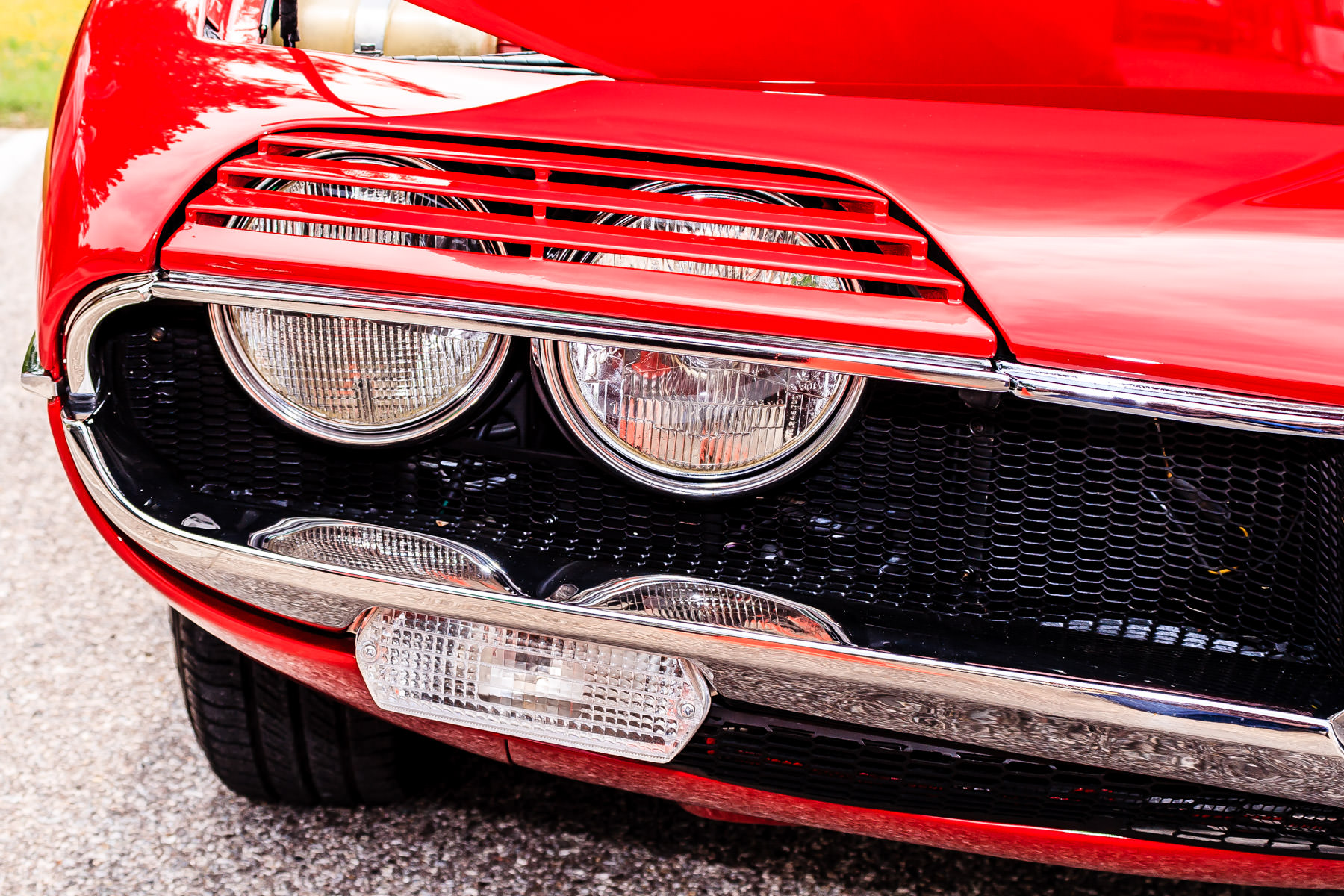 Detail of an Alfa Romeo Montreal, a sports coupe that was produced from 1970-1977 and so-named because it was introduced as a concept car at Expo'67 in Montréal.  This particular example was spotted at All British and European Car Day, Dallas, Texas.