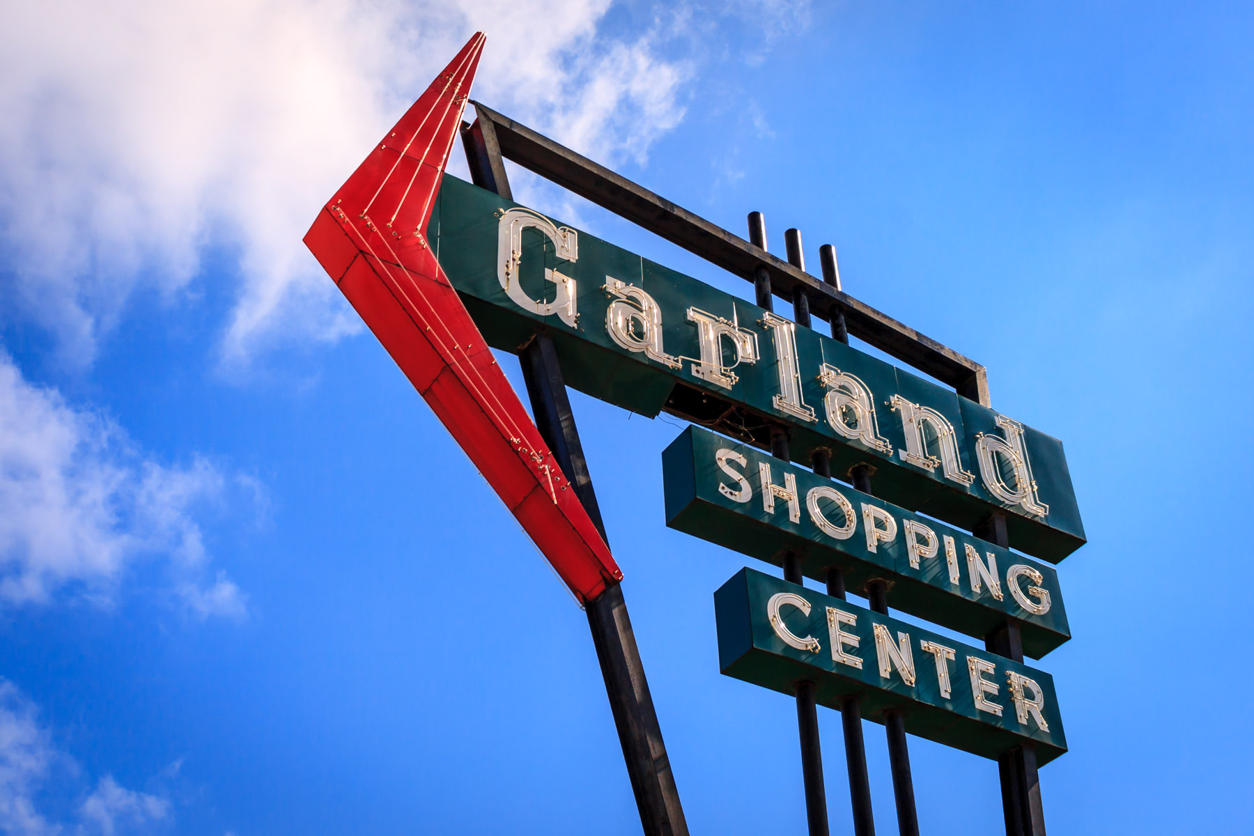 This sign is all that remains of the Garland Shopping Center, Garland, Texas.