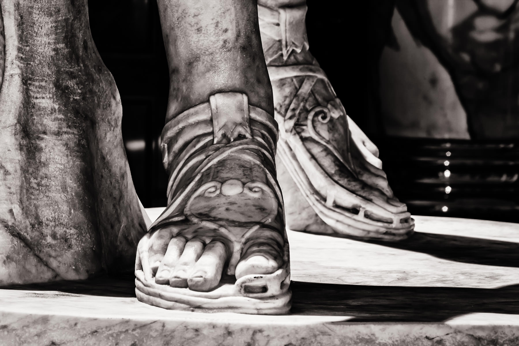 Detail of a statue's feet at Caesars Palace, Las Vegas.