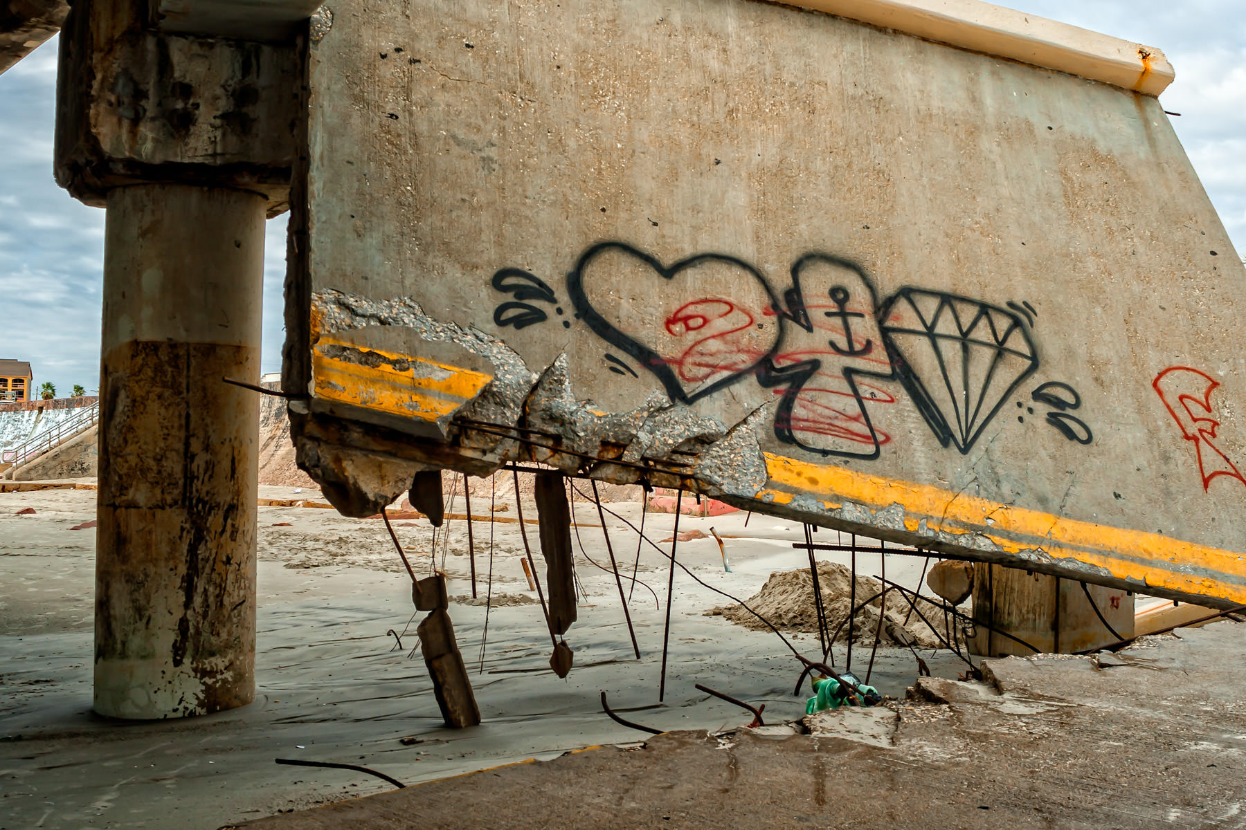 Graffiti on a piece of the crumbled, Hurricane Ike-damaged pier that supports the abandoned Flagship Hotel in Galveston, Texas.