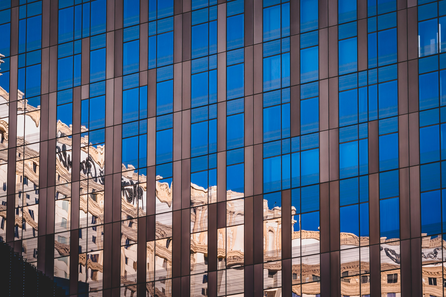 Las Vegas' Monte Carlo Hotel and Casino, abstracted by reflection in the adjacent Mandarin Oriental Hotel.
