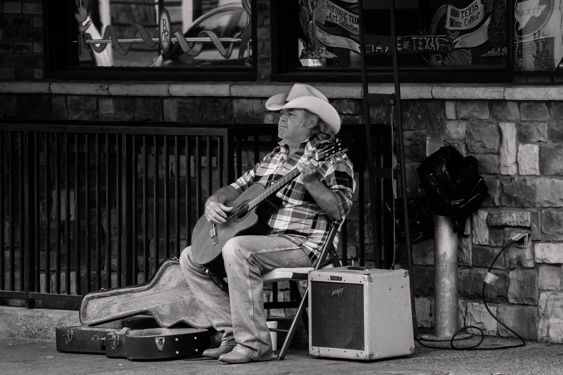 A guitarist spotted busking at the Fort Worth Stockyards.