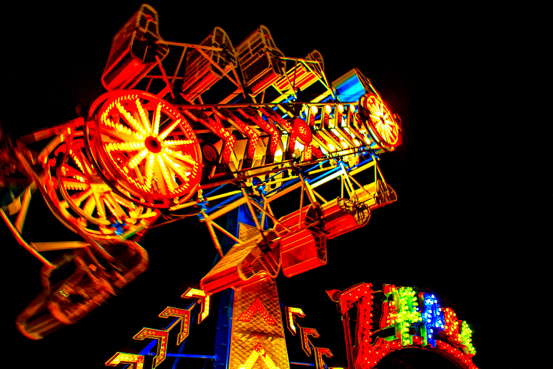 A night shot of a Zipper thrill ride at the carnival part of Addison Oktoberfest, Addison, Texas.