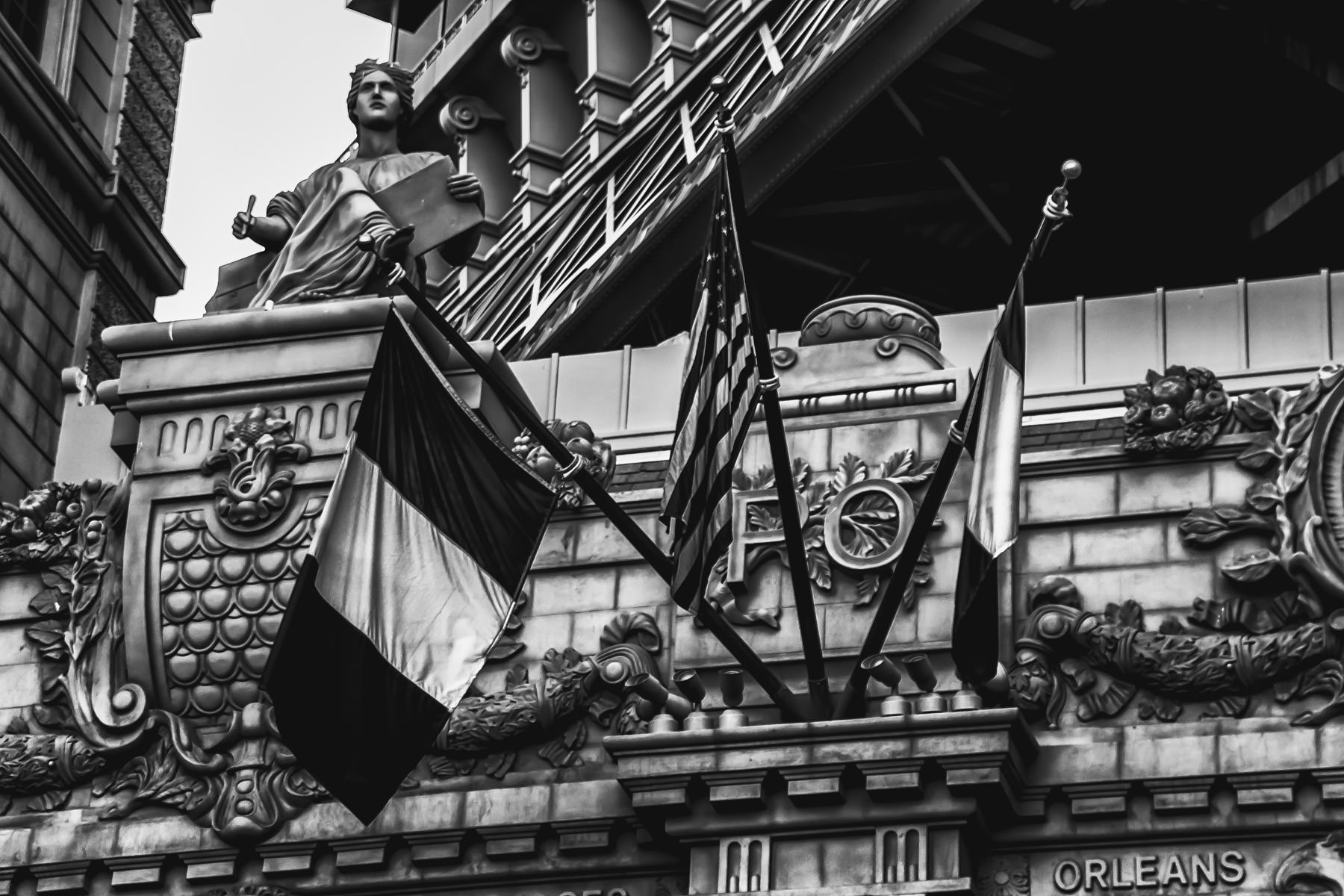 French and American flags and architectural detail on the exterior of Paris Hotel and Casino, Las Vegas.
