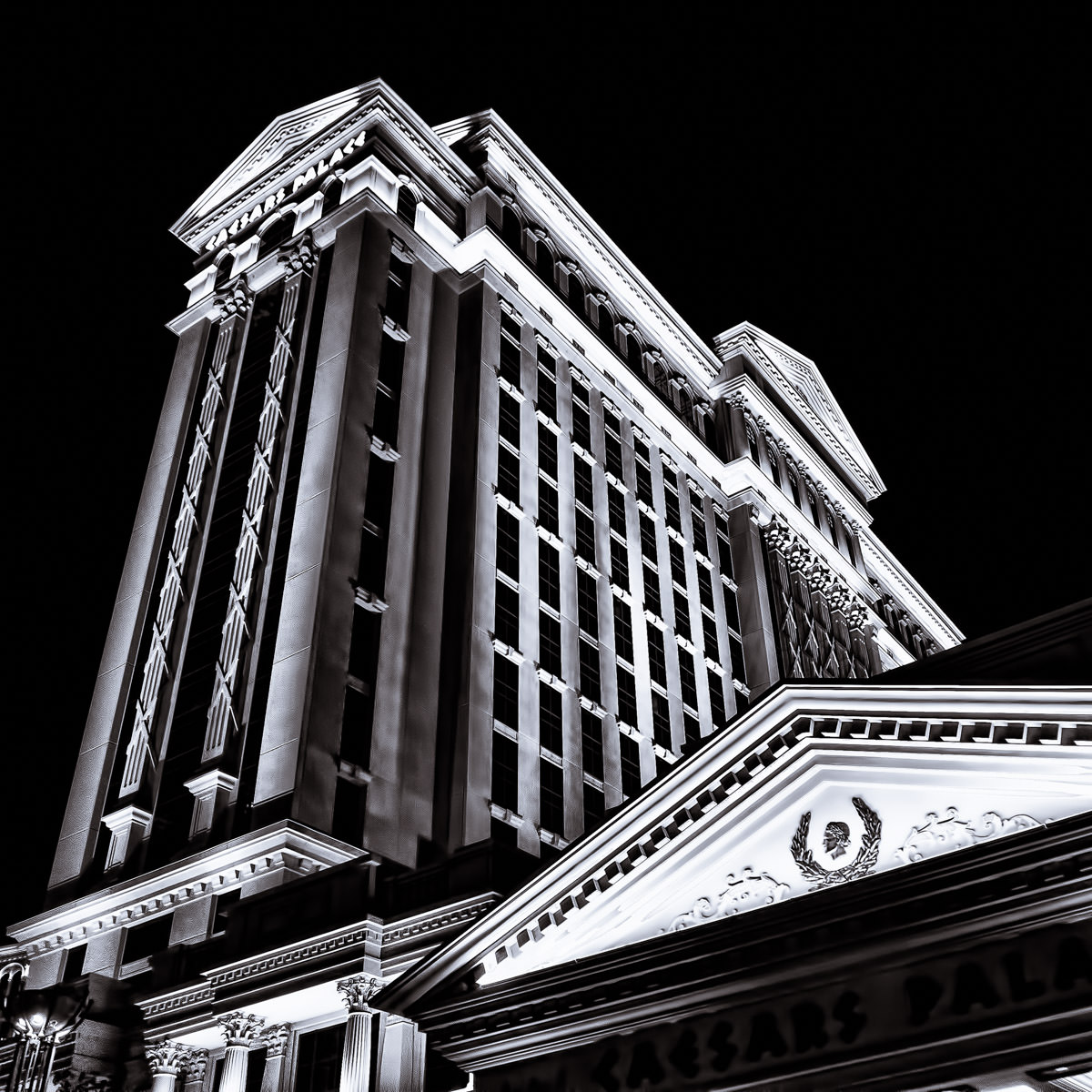 Caesars Palace's Augustus Tower rises into the night sky over Las Vegas.