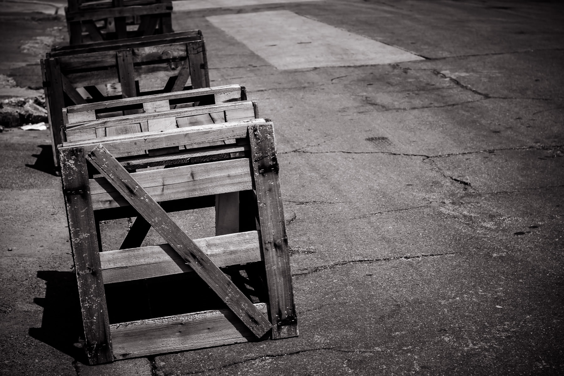 A line of crates being used to block access to a road in Oak Cliff, Dallas.