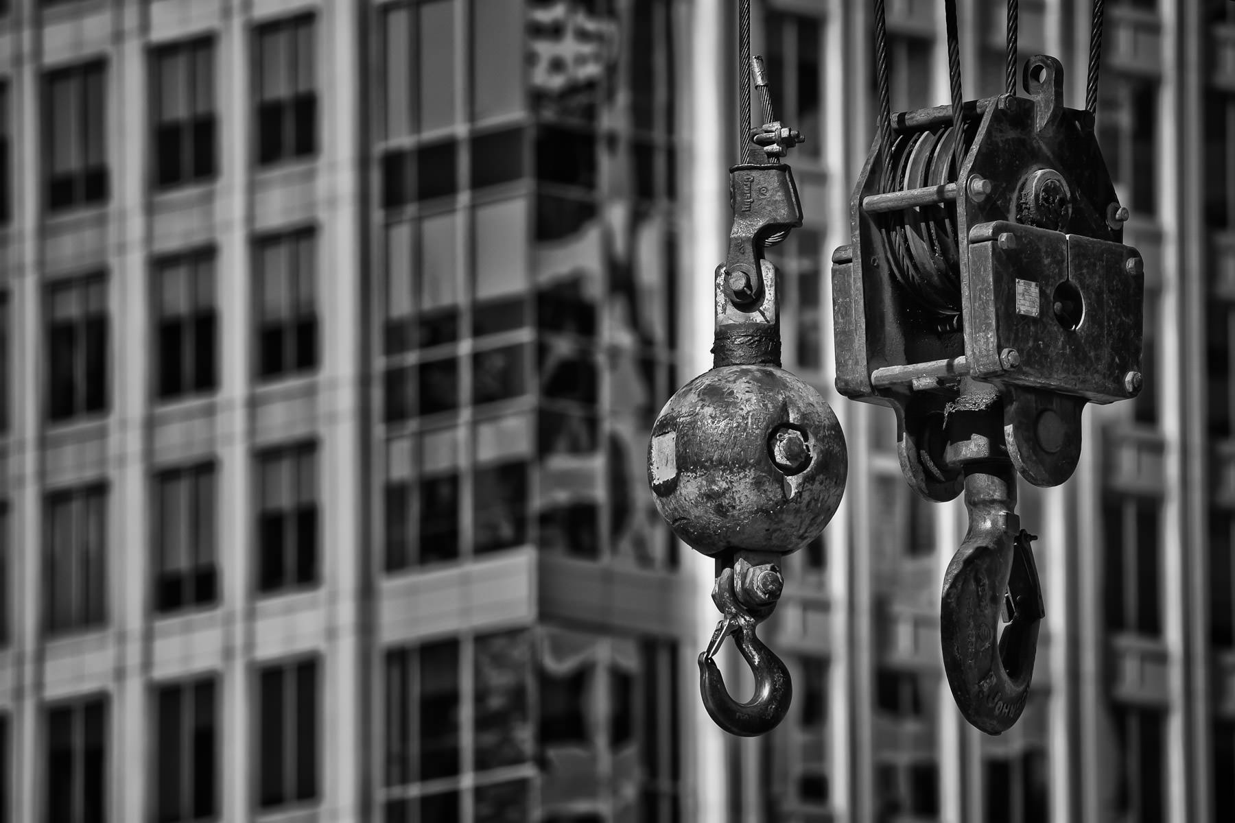 Detail of a crane's pulleys in at a construction site in Dallas' Arts District.