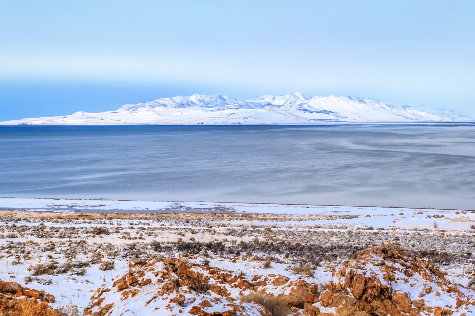 A mountain rises from the Great Salt Lake, Utah, as seen from Antelope Island.