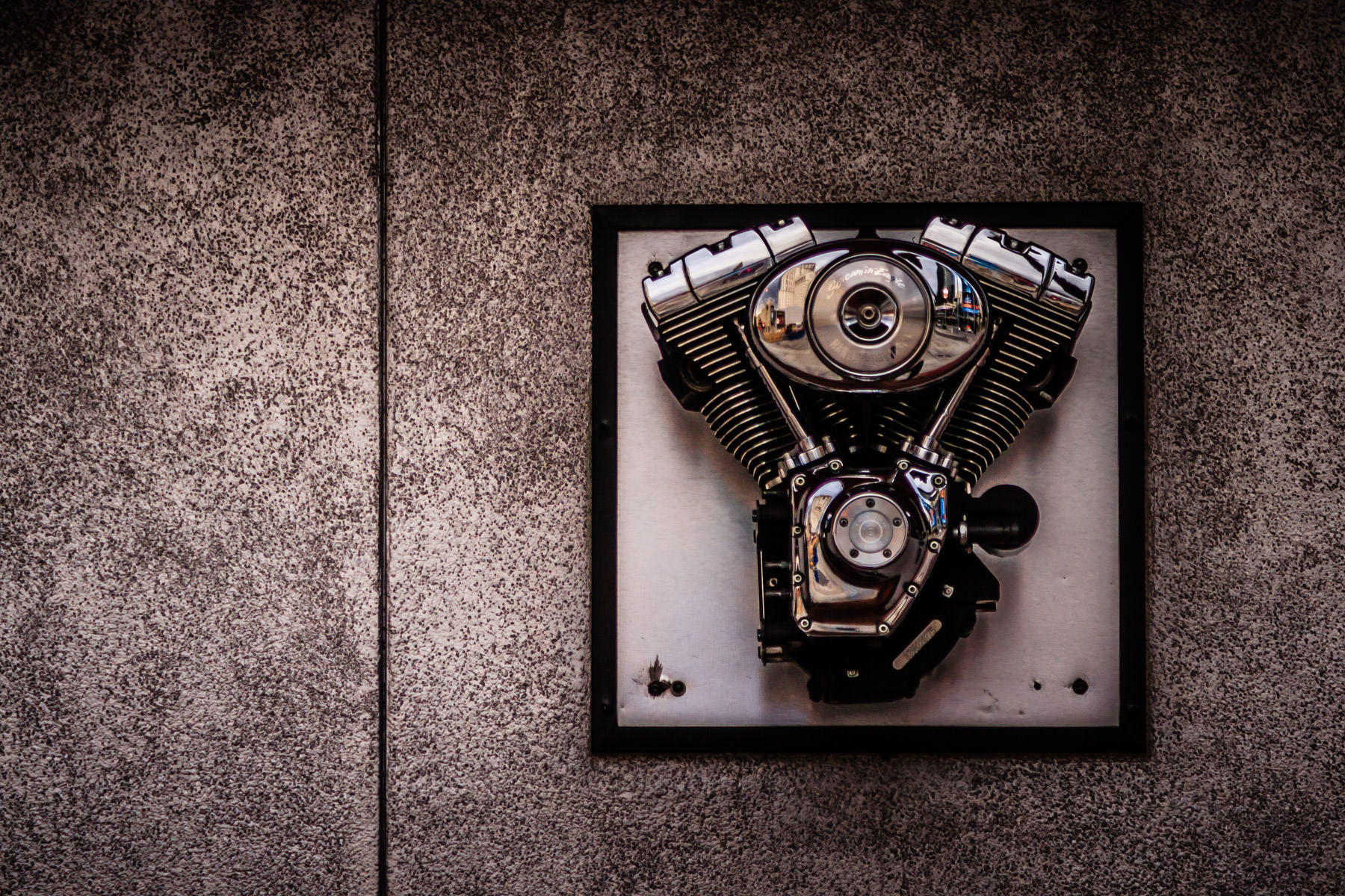A V-Twin motorcycle engine mounted on a wall outside of the Harley-Davidson Cafe in Las Vegas.