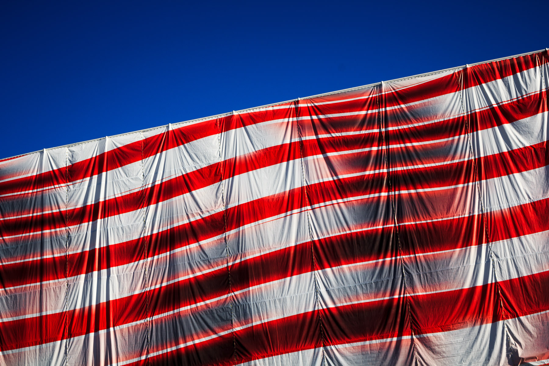 An American flag tarp covering construction scaffolding at a site on the Las Vegas Strip.