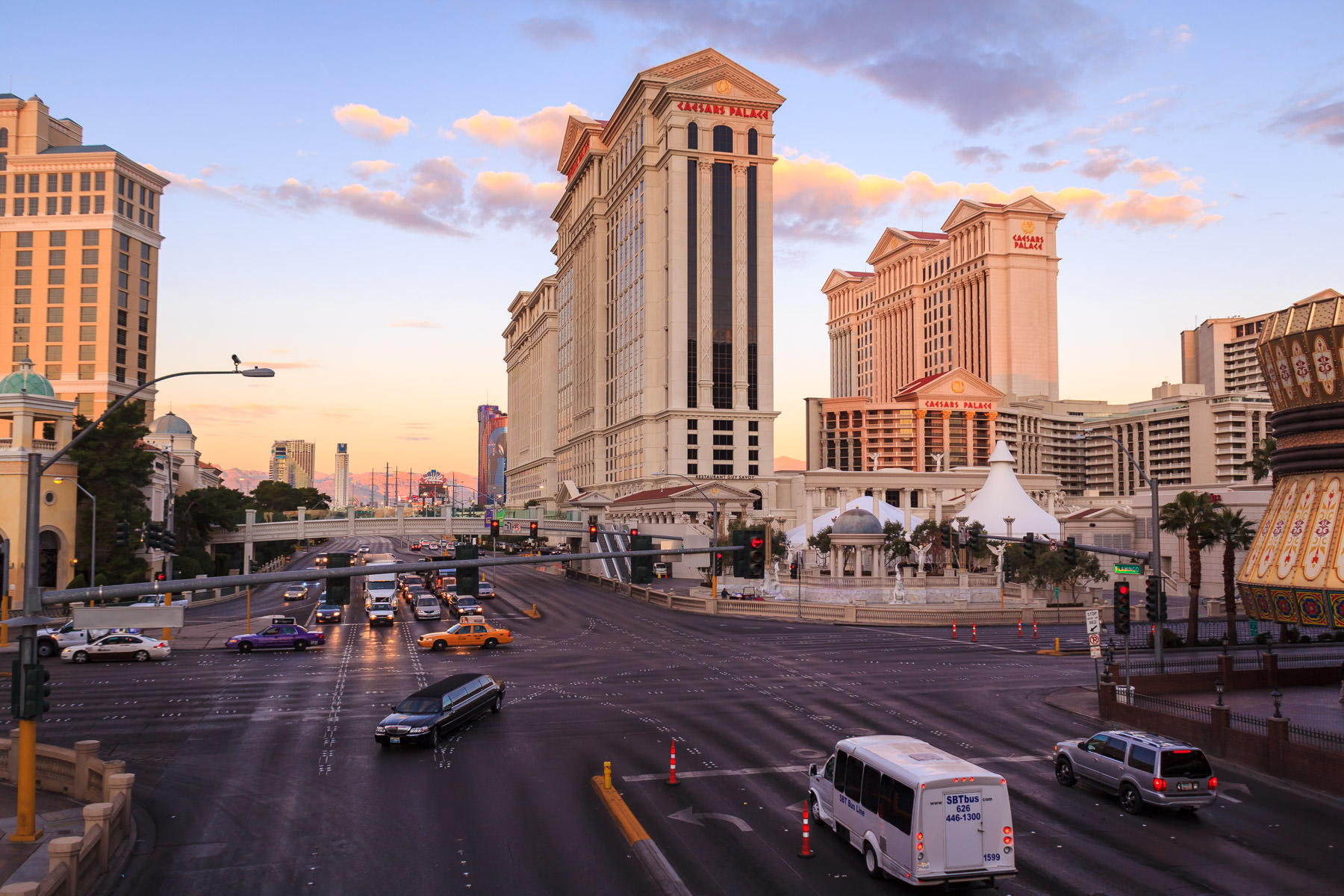 The early morning sun rises over Caesars Palace and the intersection of Flamingo Road and Las Vegas Boulevard.