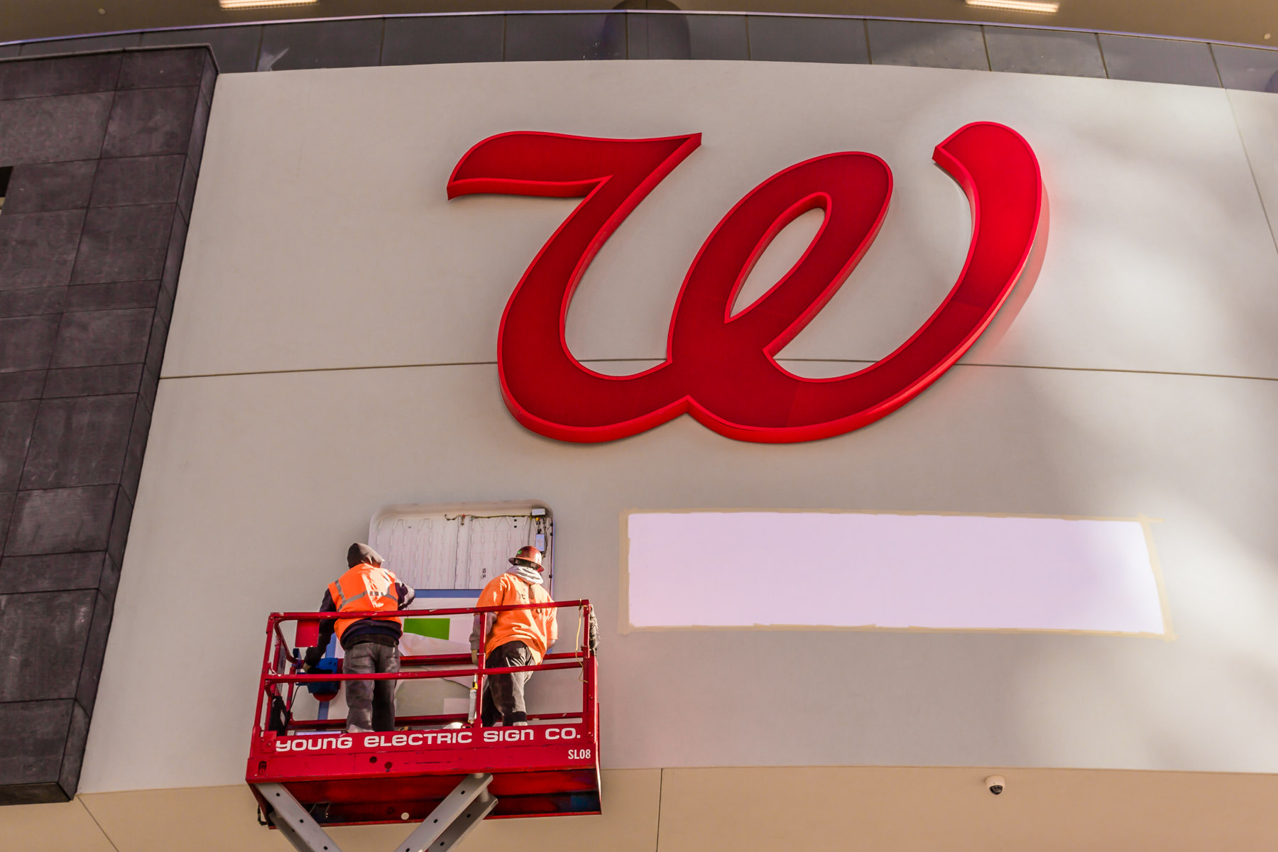 Employees of the Young Electric Sign Company—creators of most of Las Vegas' iconic signs—install signage at a new Walgreens on The Strip, adjacent to Planet Hollywood.