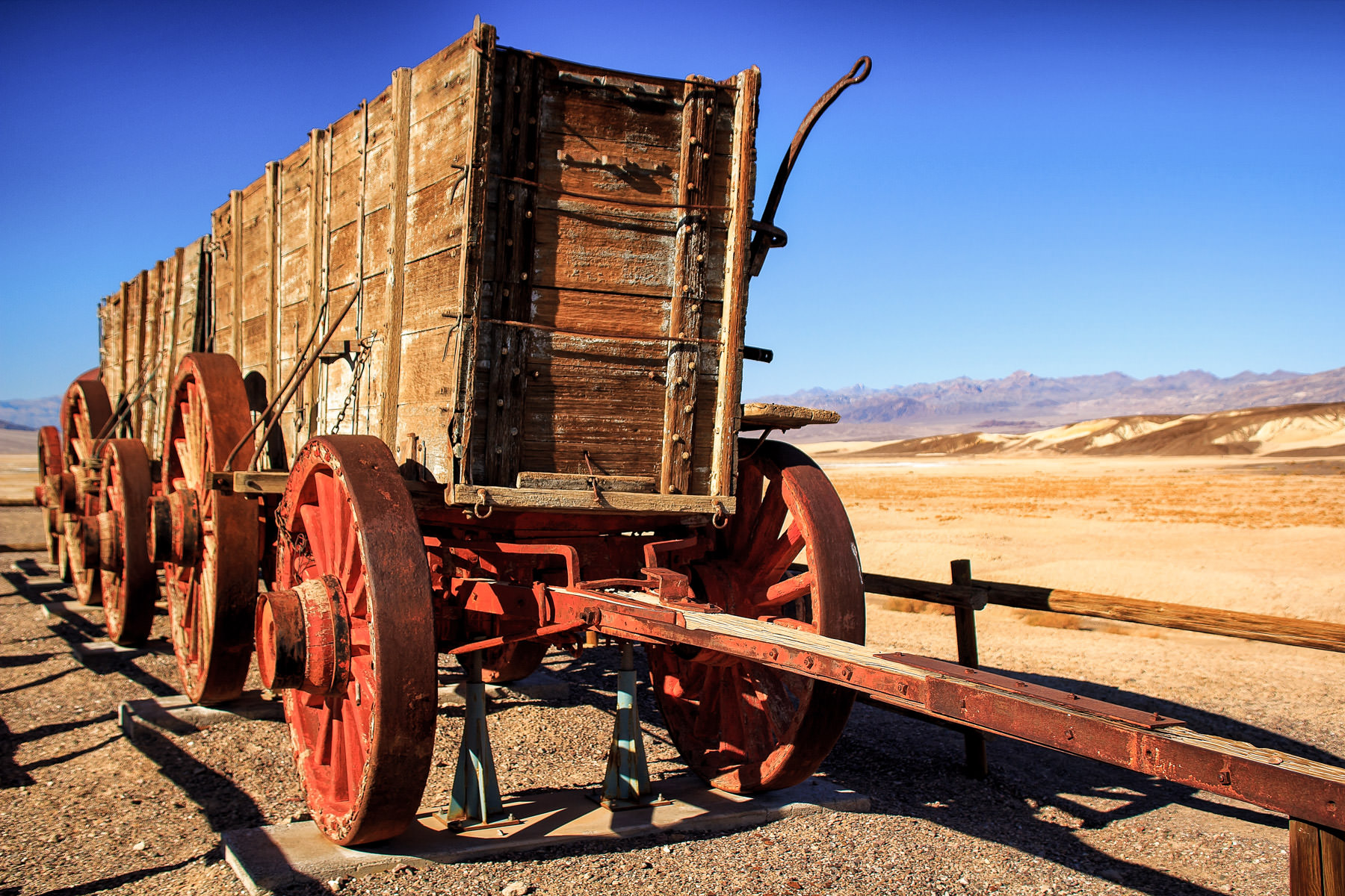 Old wagons for hauling borax on display in Death Valley National Park, California.