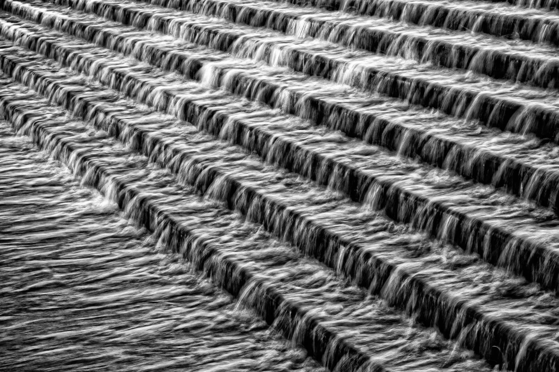 Water flows down a stairs-like fountain on the campus of Tarrant County College's Trinity River East Campus, Fort Worth, Texas.