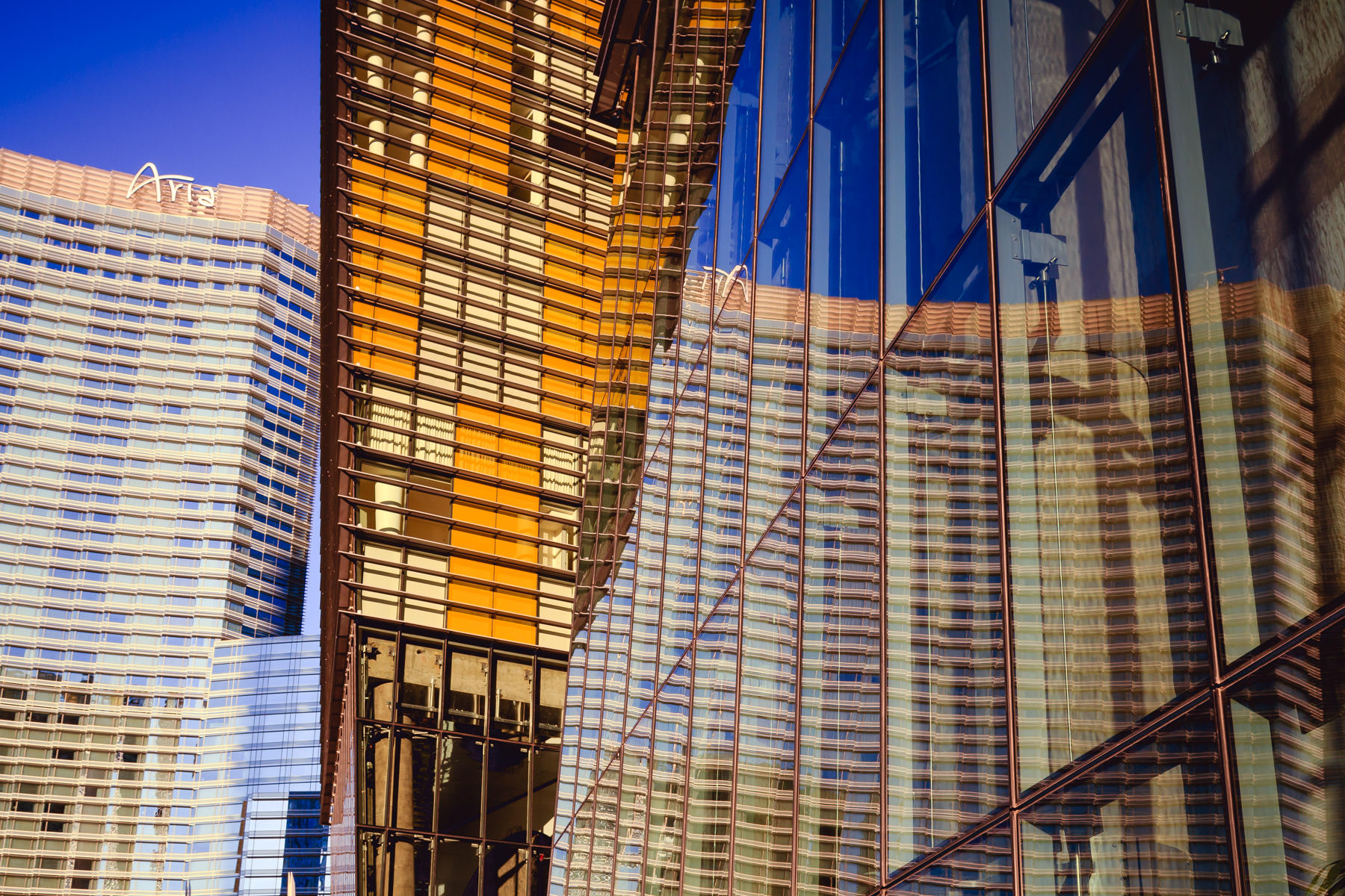 The Aria reflected in the lower level windows of the west Veer Tower, CityCenter, Las Vegas.