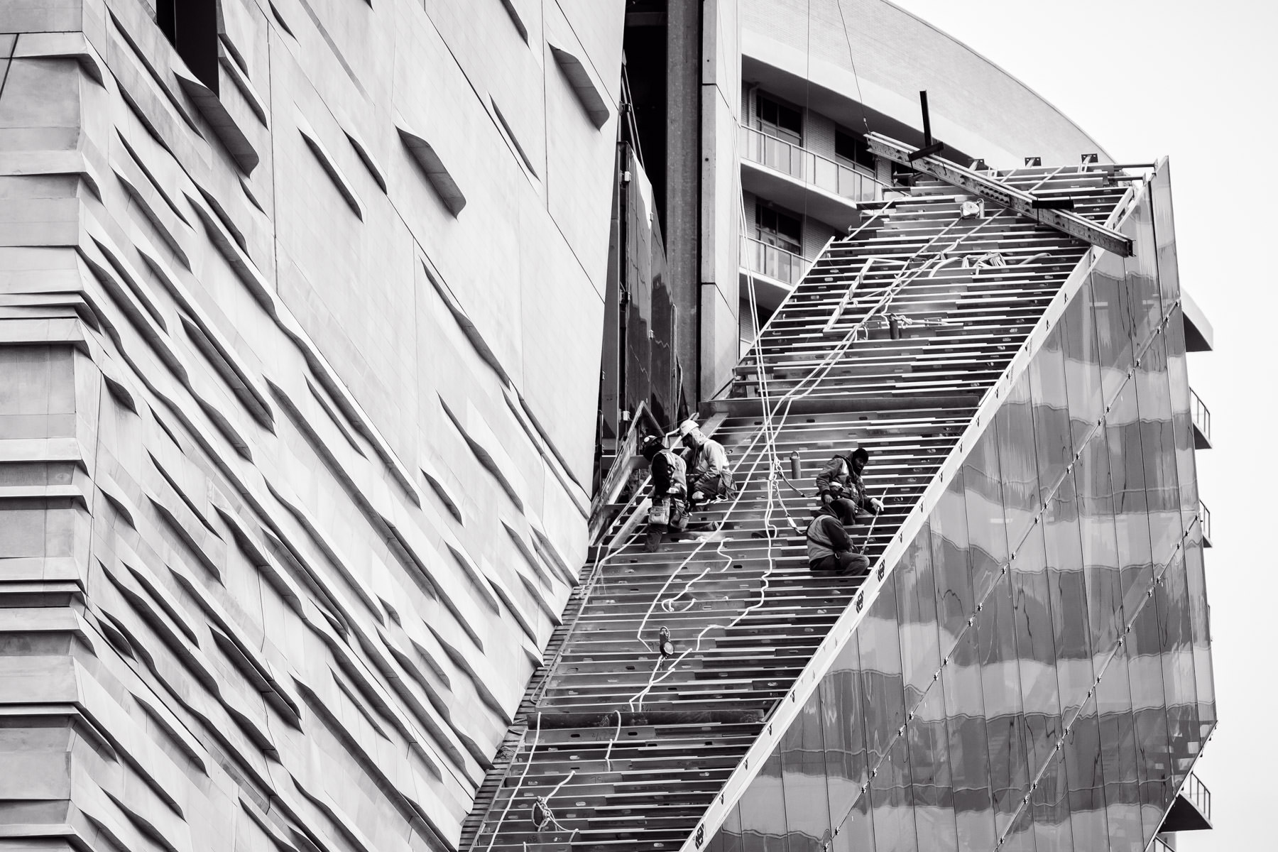 Workers on the Perot Museum of Nature and Science—designed by Pritzker Prize winner Thom Payne—near the West End of Downtown Dallas.