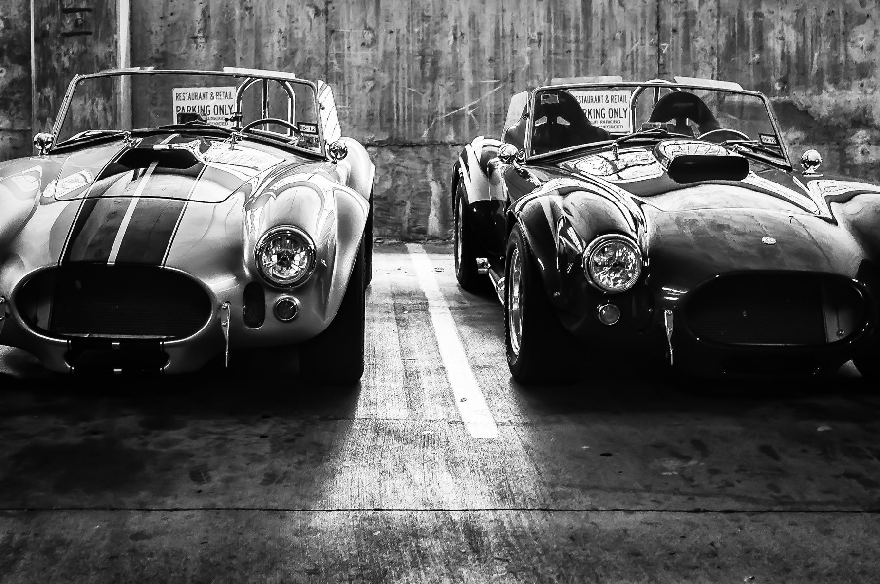 Two AC Cobras in a parking garage in Addison, Texas.