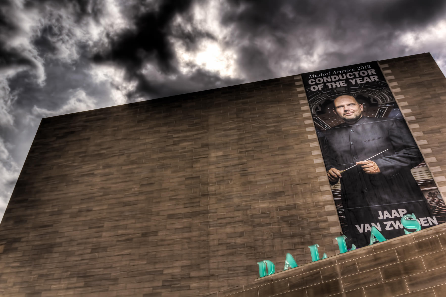 A banner featuring the Dallas Symphony Orchestra's conductor, Jaap Van Zweden, on the exterior of the I.M. Pei-designed Meyerson Symphony Center.
