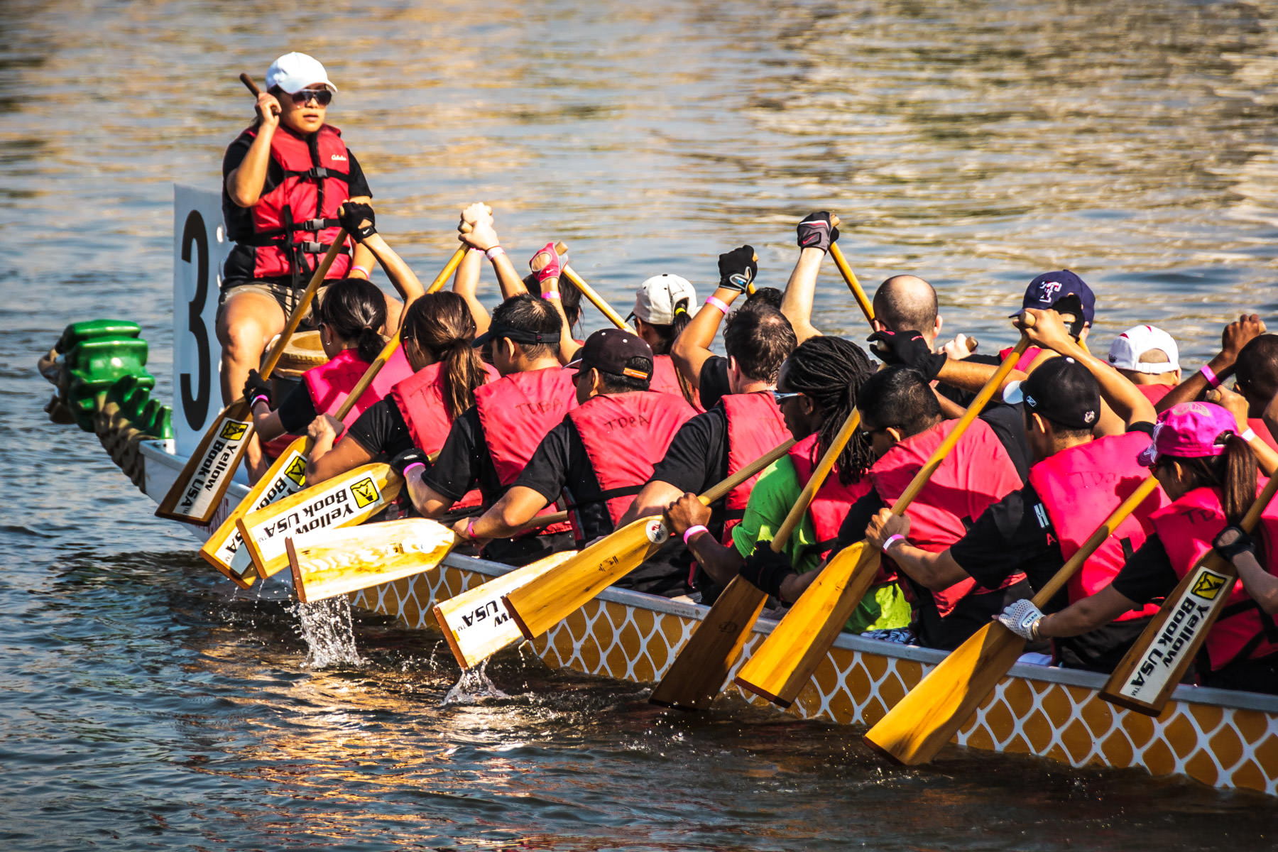 Racers rowing at the 2012 DFW Dragon Boat Festival, Lake Carolyn, Las Colinas, Irving, Texas.