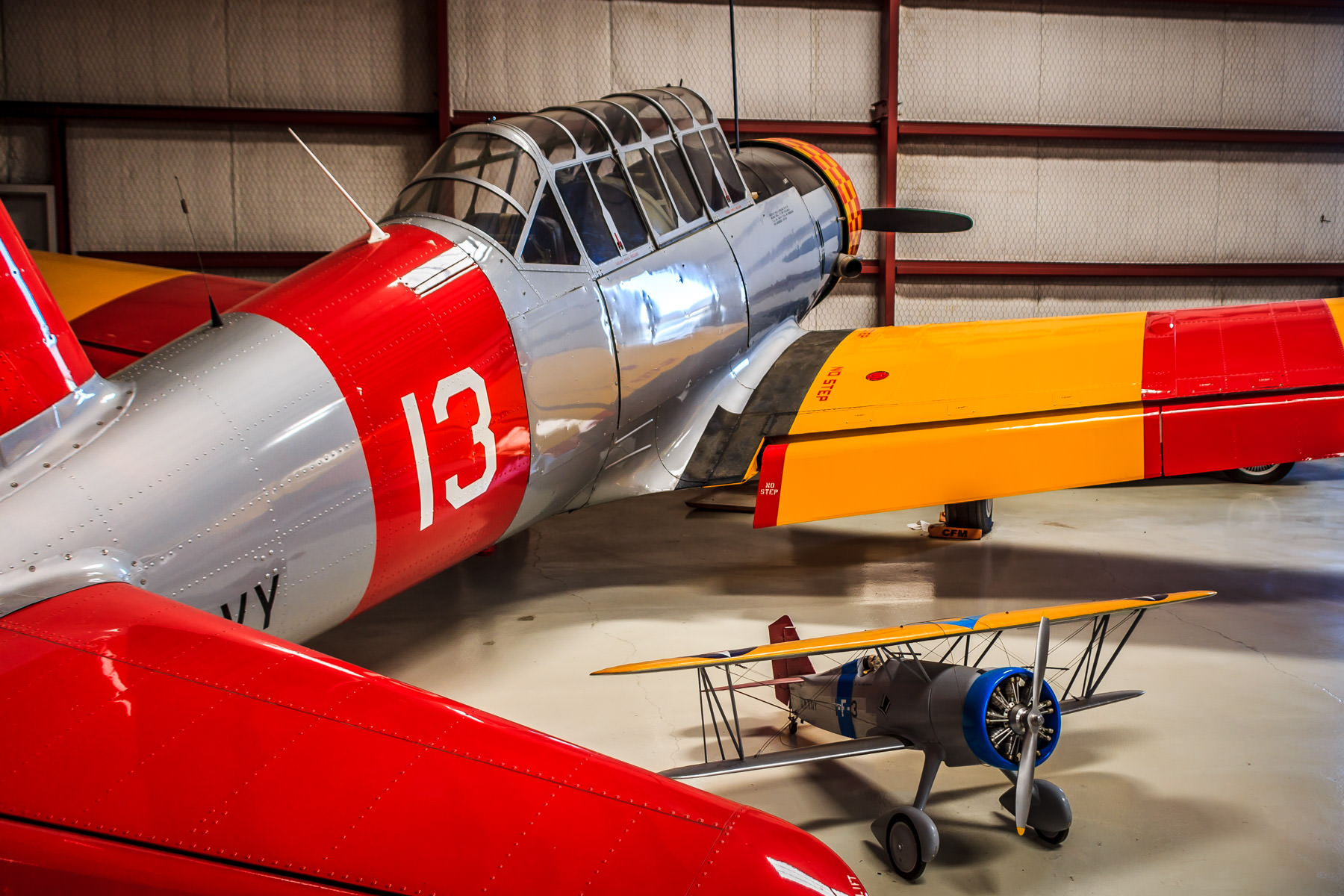 A full size-airplane and a small model of a biplane at the Cavanaugh Flight Museum, Addison, Texas.