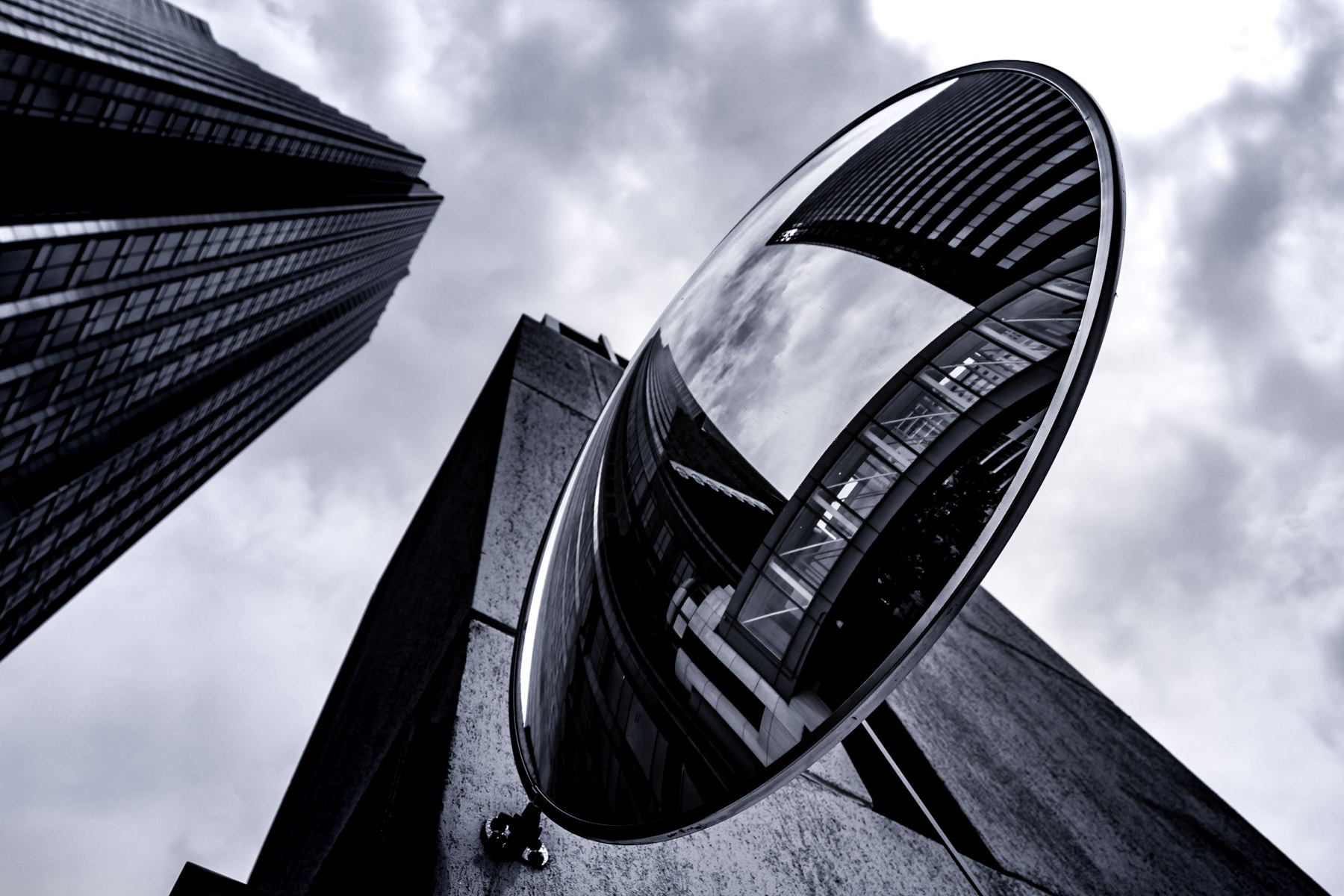 Buildings reflected in a convex mirror in Downtown Dallas.