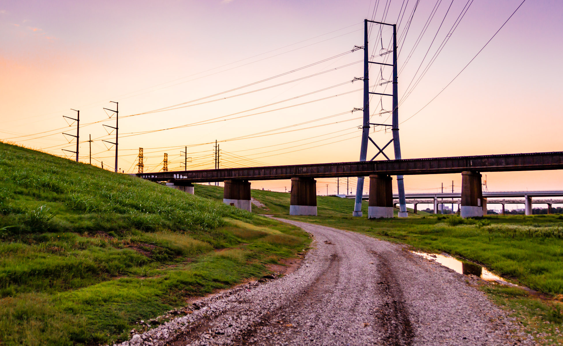 The sun sets in Dallas in this shot of bridges and power lines in the Trinity River corridor.