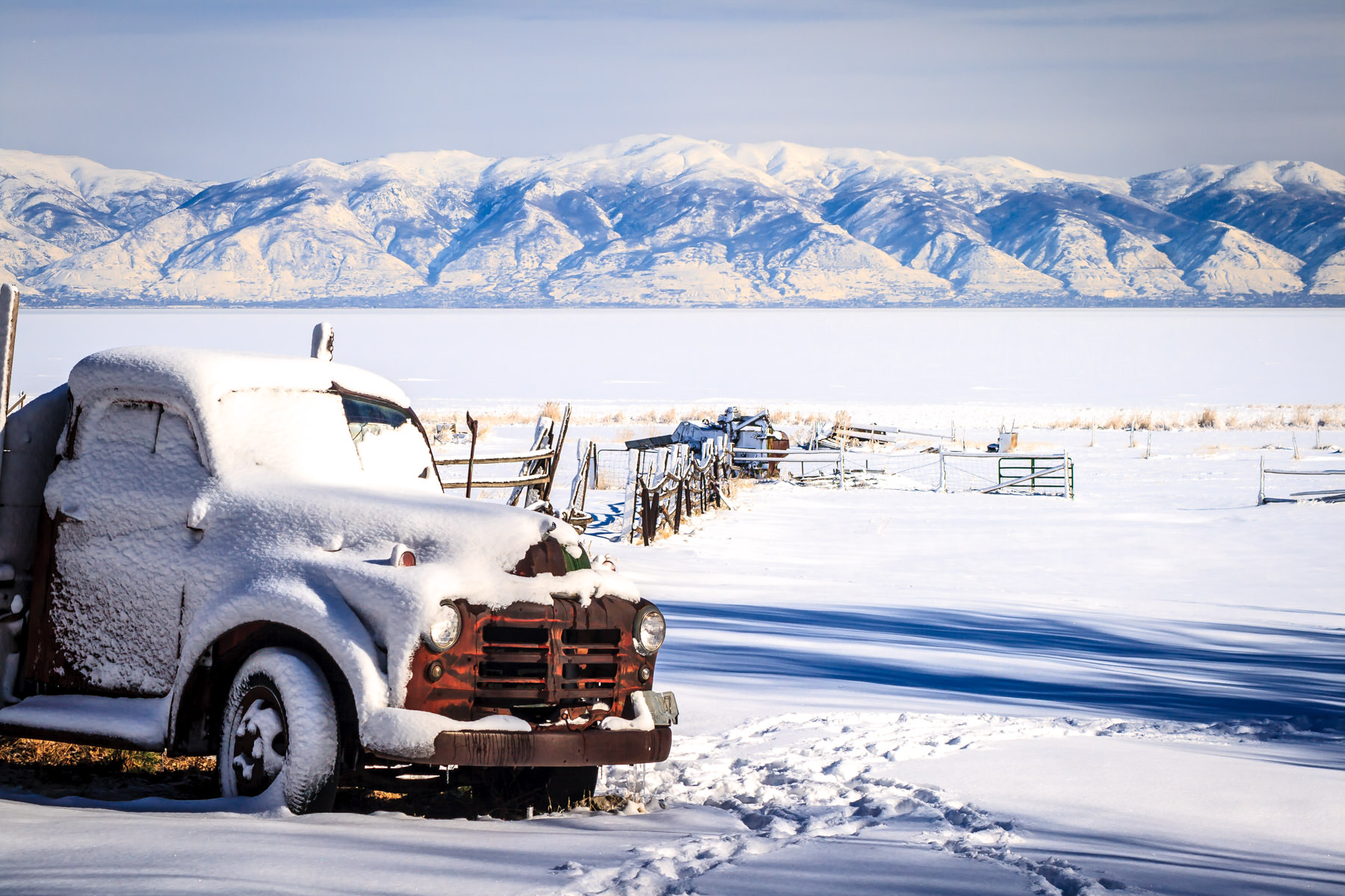 An abandoned, snow-covered truck on Antelope Island in the Great Salt Lake, Utah.