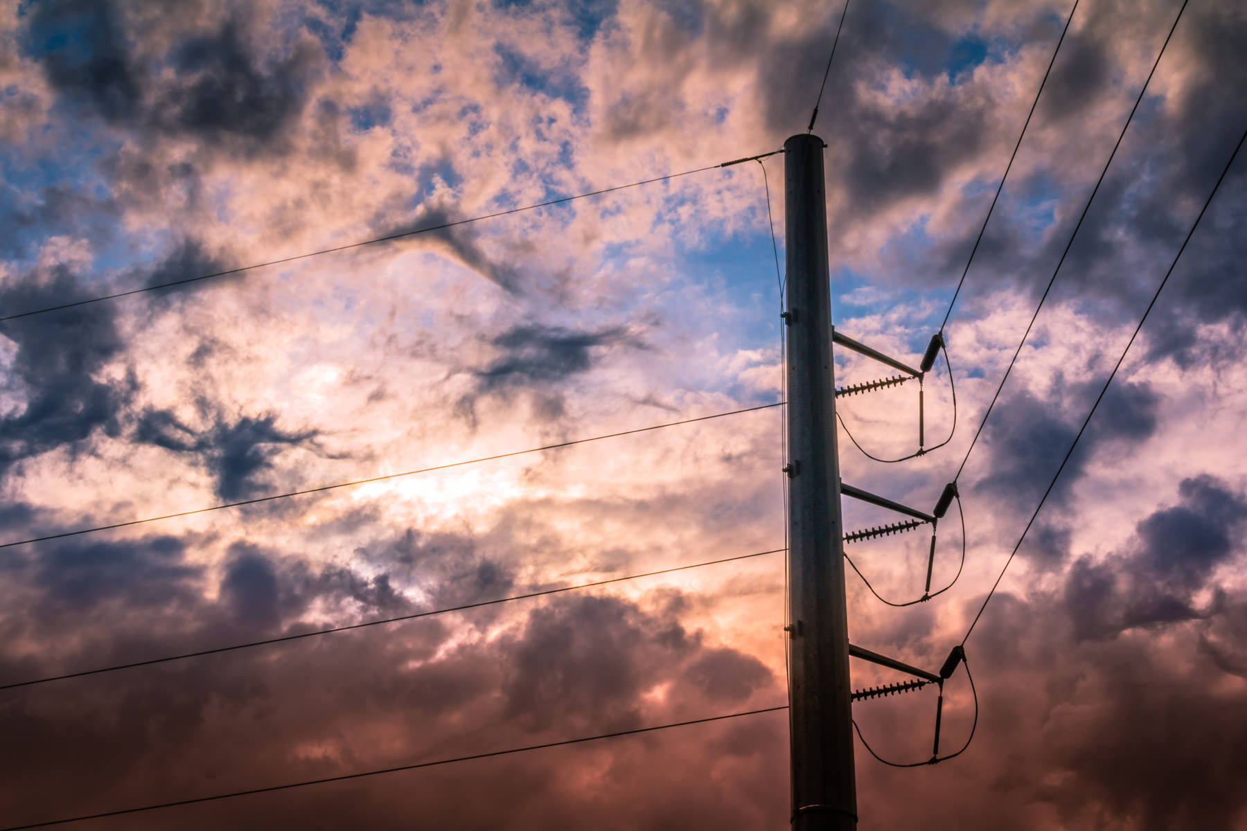 Power lines against a stormy sky, spotted in Richardson, Texas.