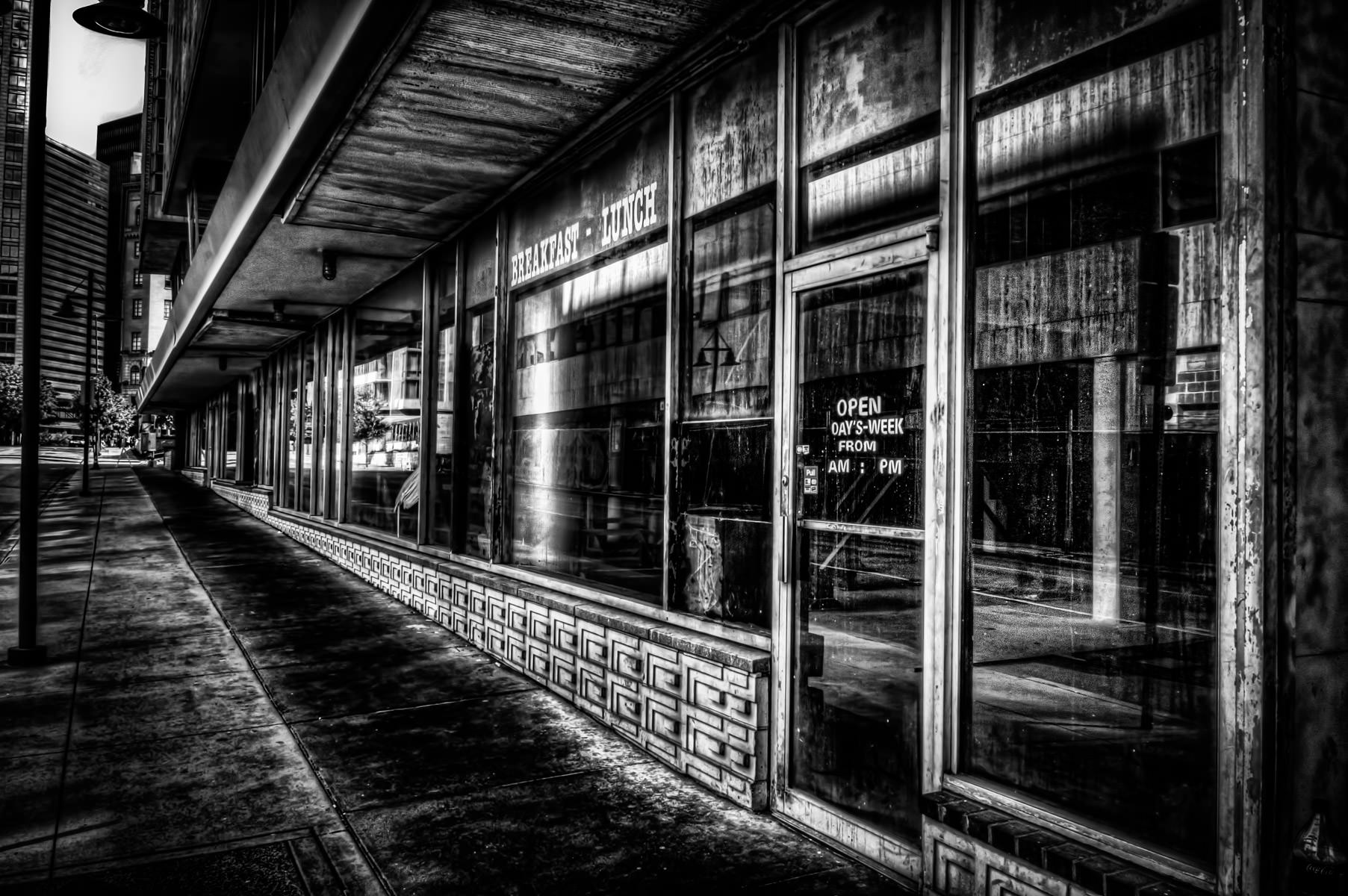 Abandoned storefronts at the base of Dallas' long-deserted yet soon-to-be-reborn Statler Hilton Hotel.