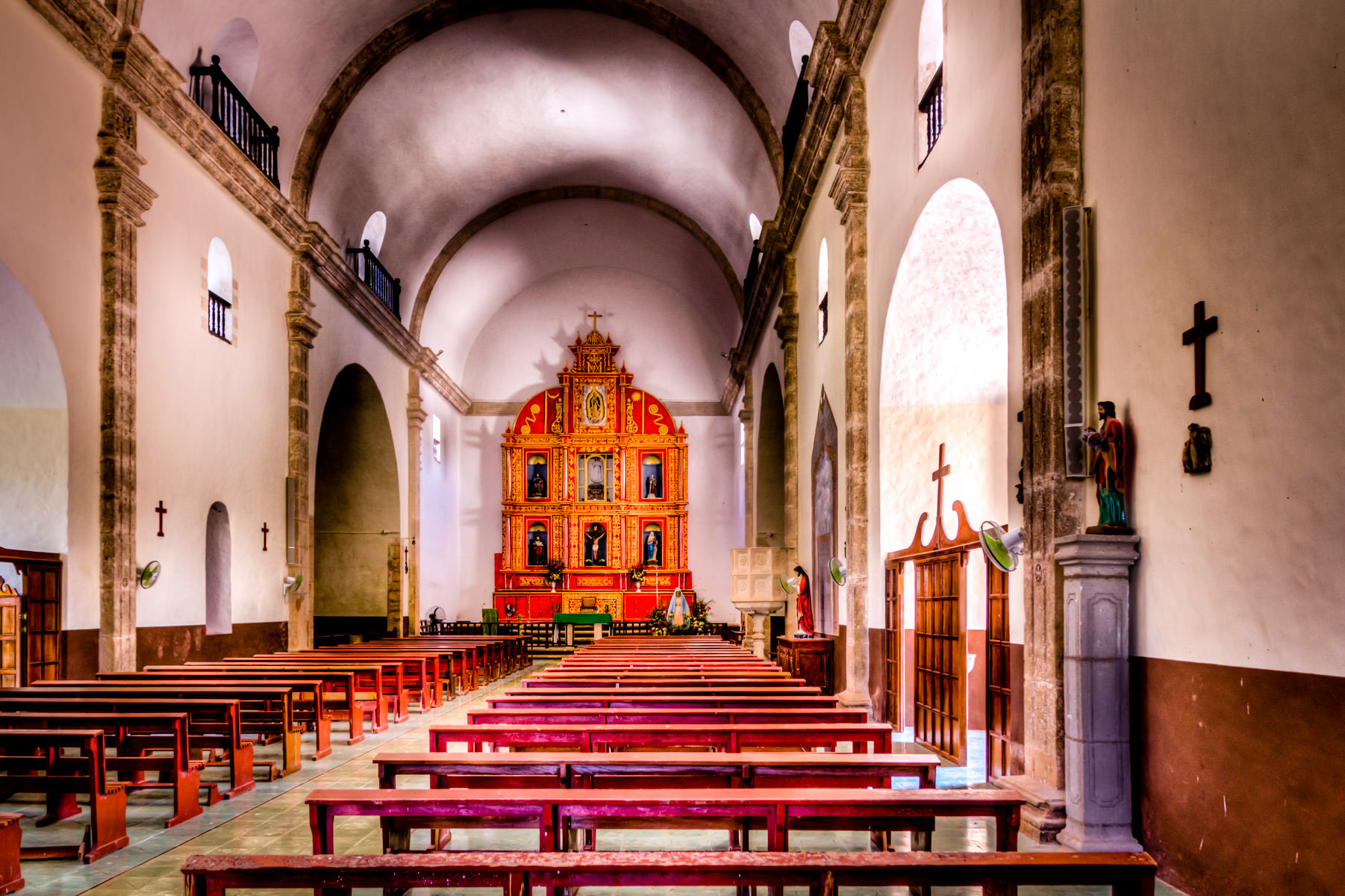 The simple interior of the Catholic church in Dzemul, Yucatan, Mexico.
