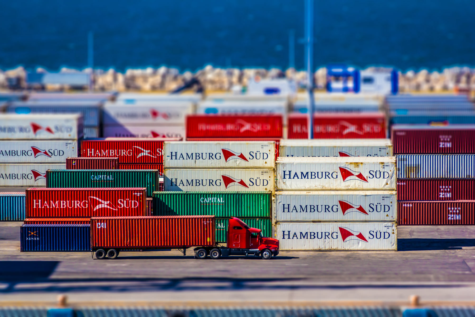 Containers stacked in a cargo terminal in Progreso de Mérida, Yucatán, Mexico.