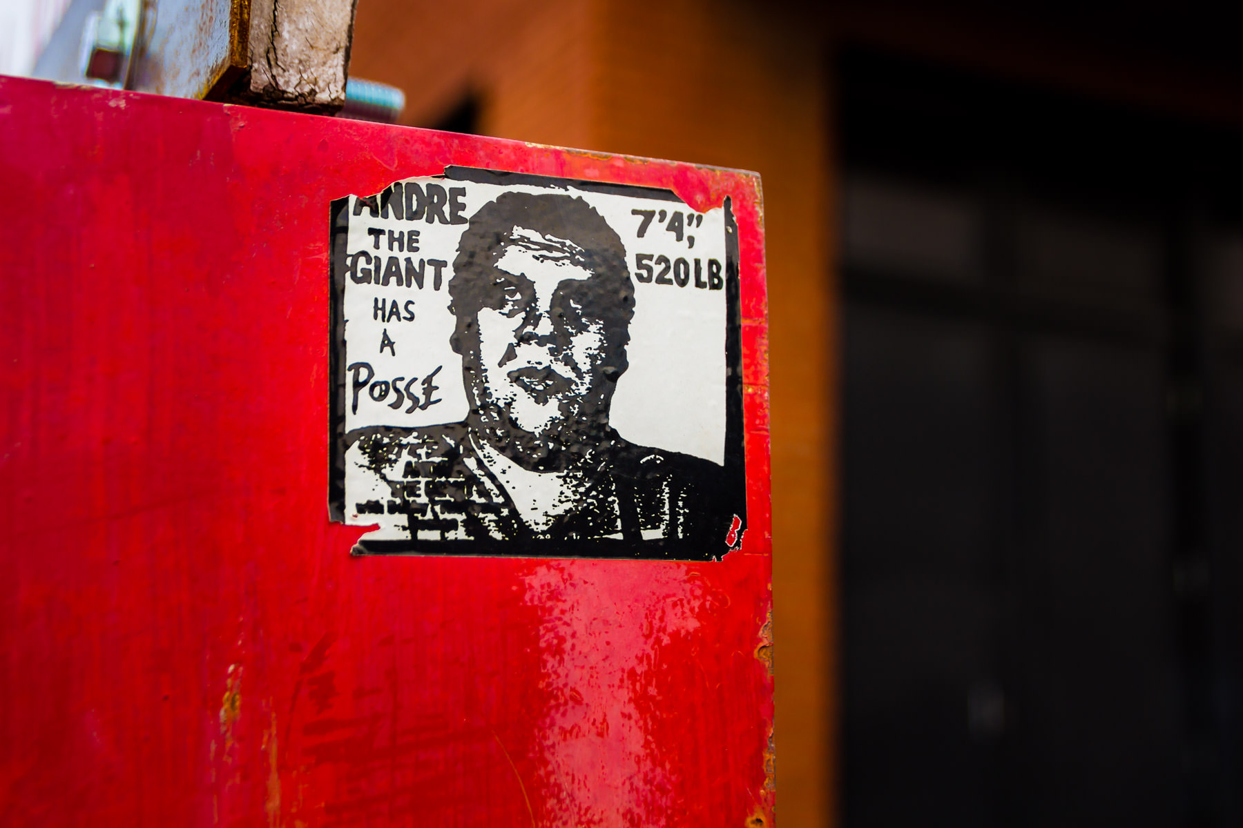 "A sticker from artist Shepard Fairey's iconic ""experiment in phenomenology"", spotted in Deep Ellum, Dallas."