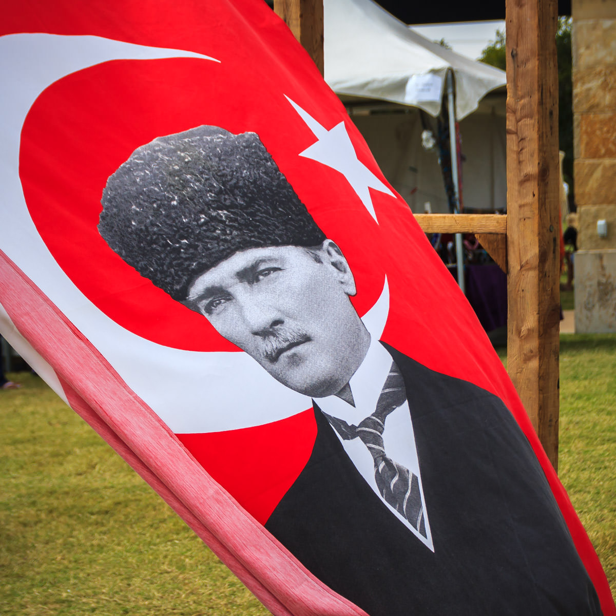 A banner depicting Mustafa Kemal Atatürk—first President of Turkey—waves in the wind at Addison WorldFest at Addison Circle Park, Addison, Texas.