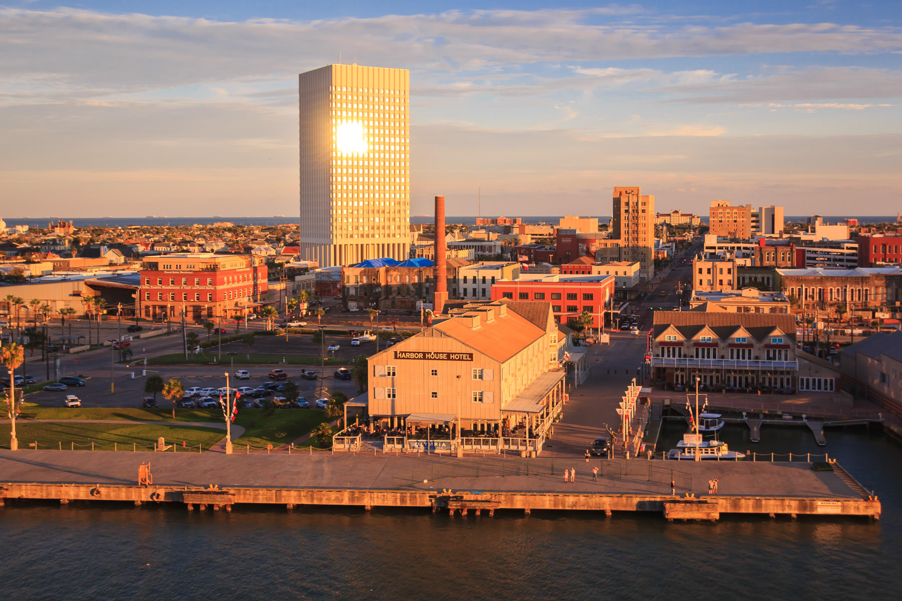 The sun sets on the 1.5-mile-wide strip of land that is Galveston Island, Texas.